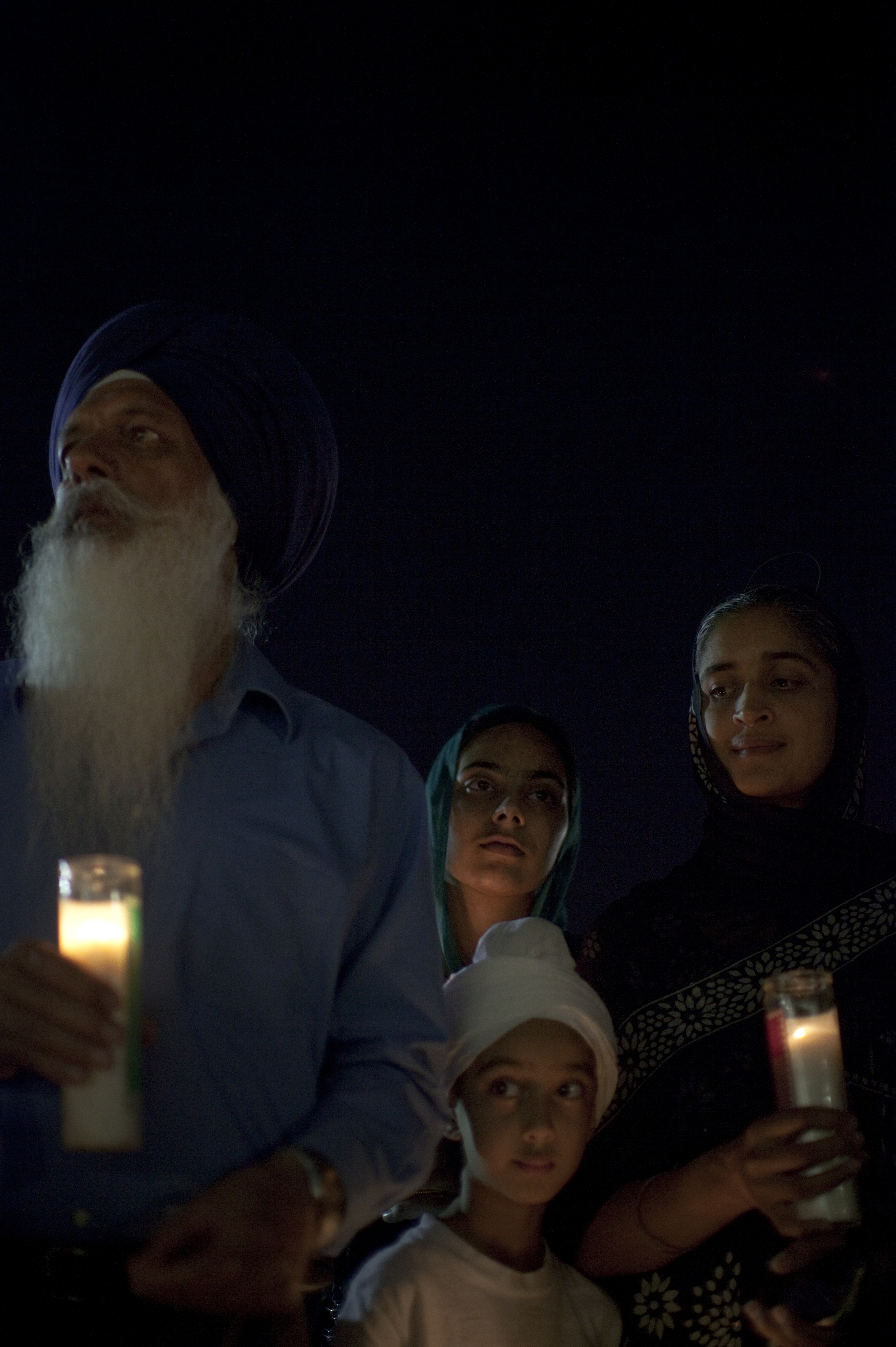 A family of the Sikh faith gathered at a candlelight vigil for sixworshipers who were shot and killedata Temple in Wisconsin by a white supremacist.