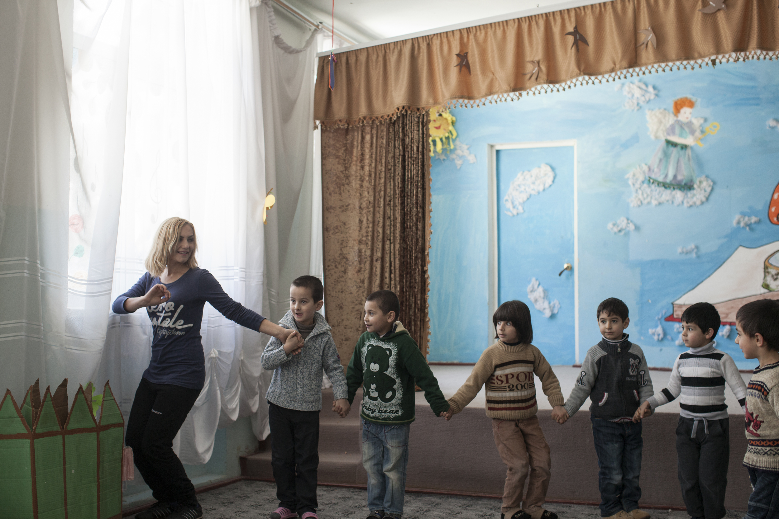 Avo and his classmates practice traditional Armenian dance at school.