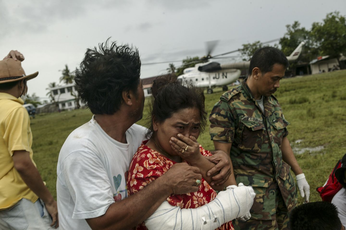 Injured survivors wait for helicopter transportation.