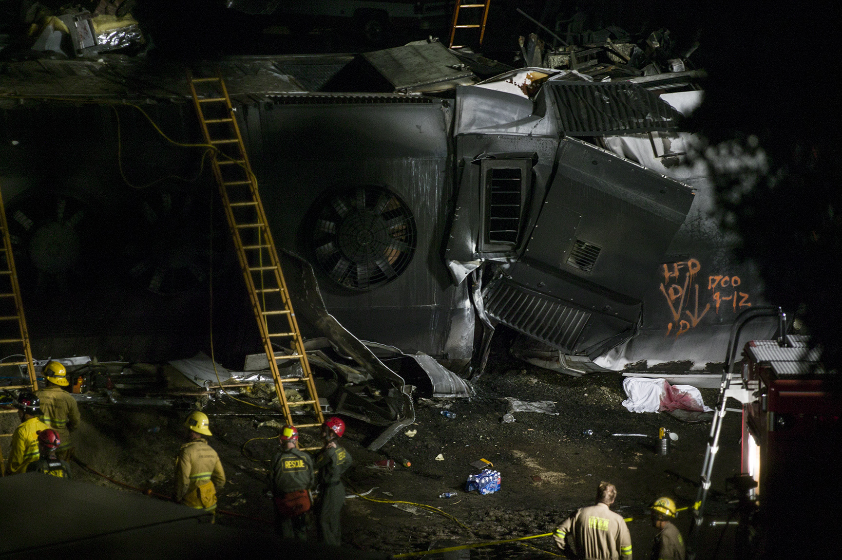 Emergency workers search for survivors at the site of a deadly train collision between a Union Pacific freight train and a Metrolink commuter train.