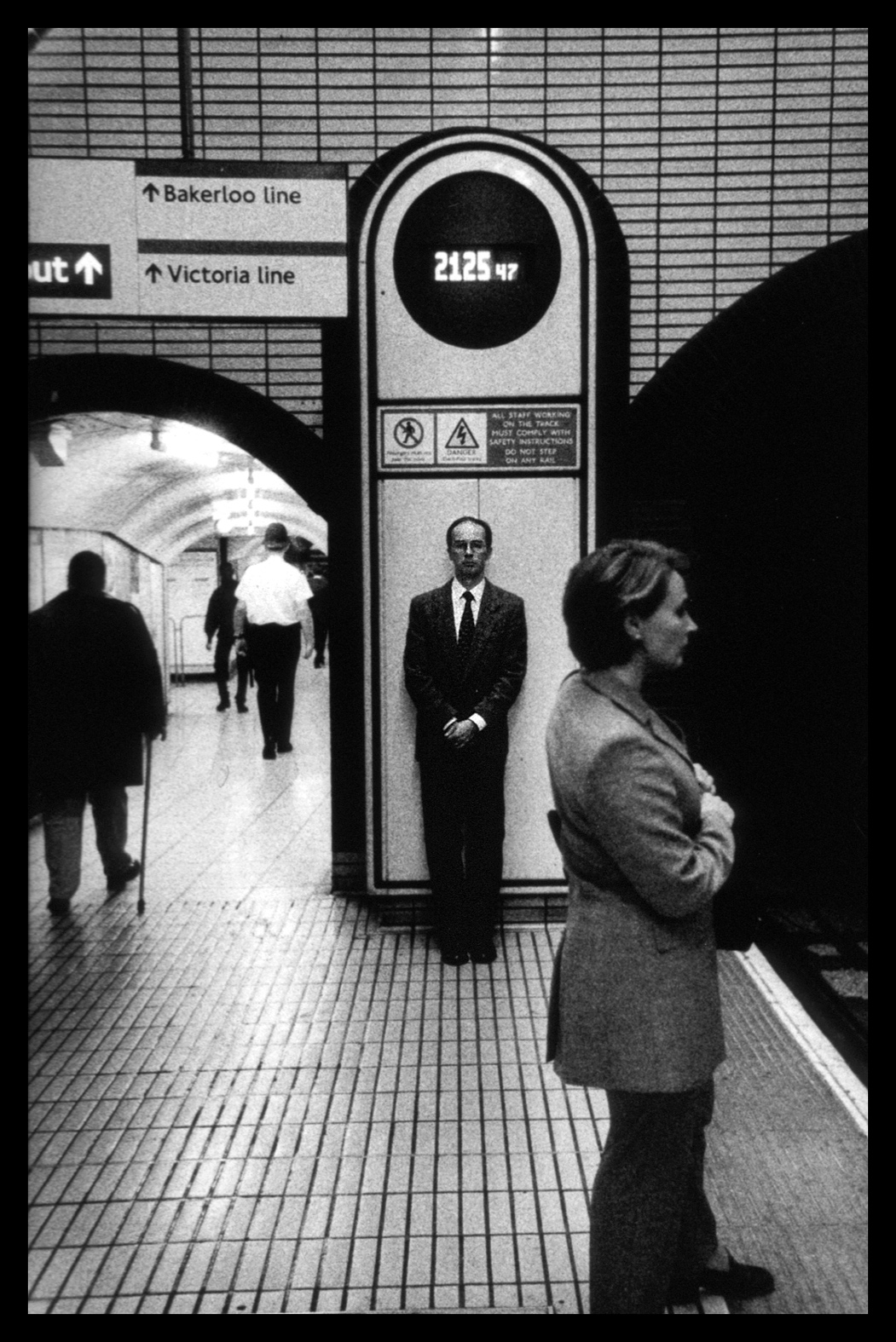 "London, England  - Series from London's metro, 1999.     ""The guard is down and the mask is off: even more than when in lone bedrooms (where there are mirrors). People's faces are in naked repose in the subway.""      - Walker Evans"