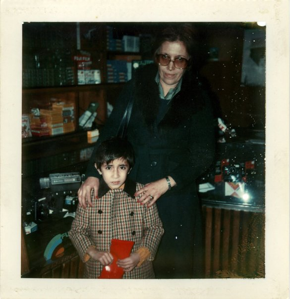 Circa 1977 Tehran, Iran.  With mom b uying a polaroid - my first camera.