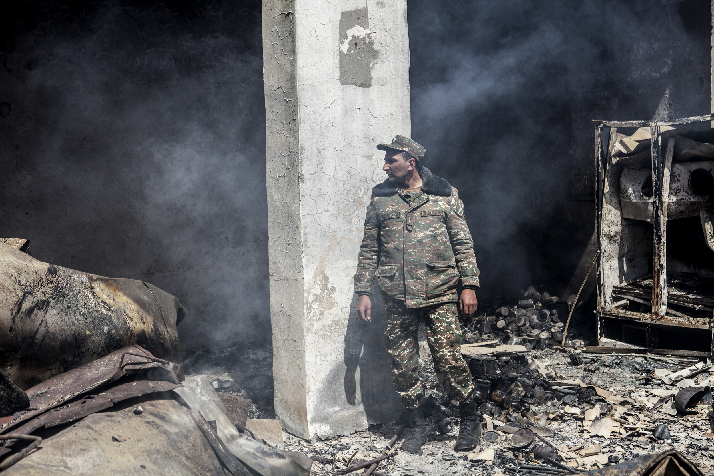 April 5 - an Armenian servicemen in a recently hit building on a base in Mataghis.