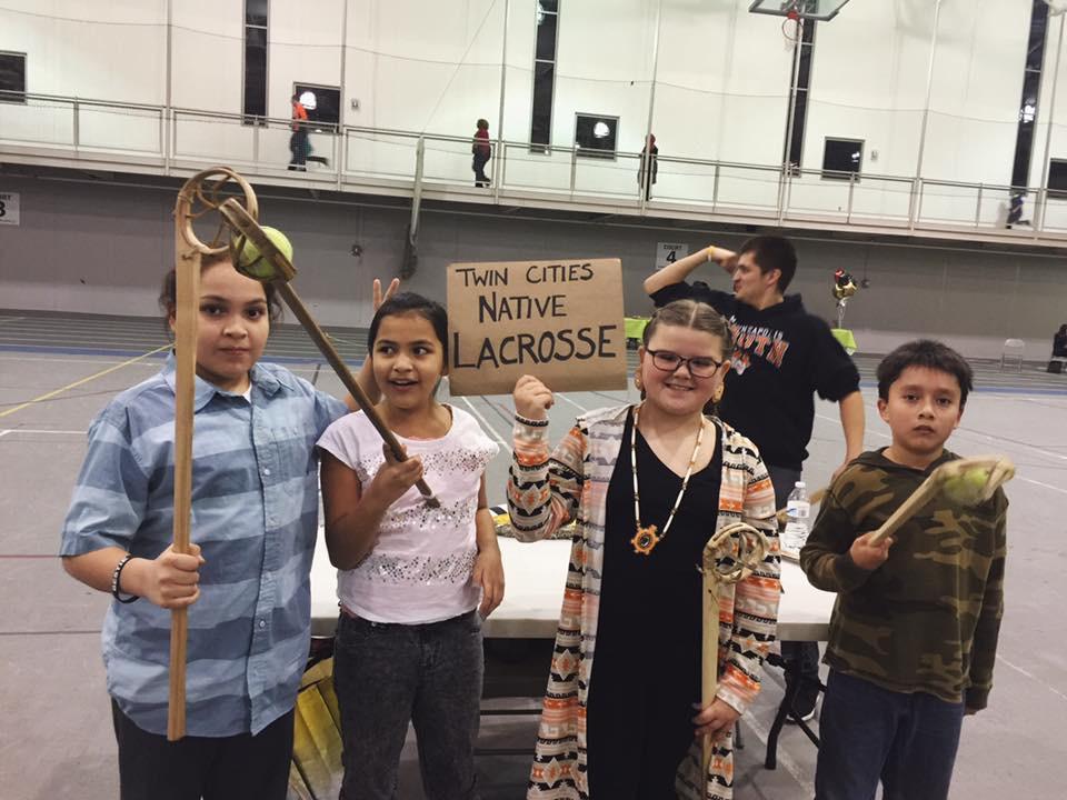 Mato Thompson, Wicahpi Thompson, Dalaney Villebrun and Ocean Walker representing Twin Cities Native Lacrosse at the Minneapolis American Indian College Fair. Photo: Sasha Lee Brown.