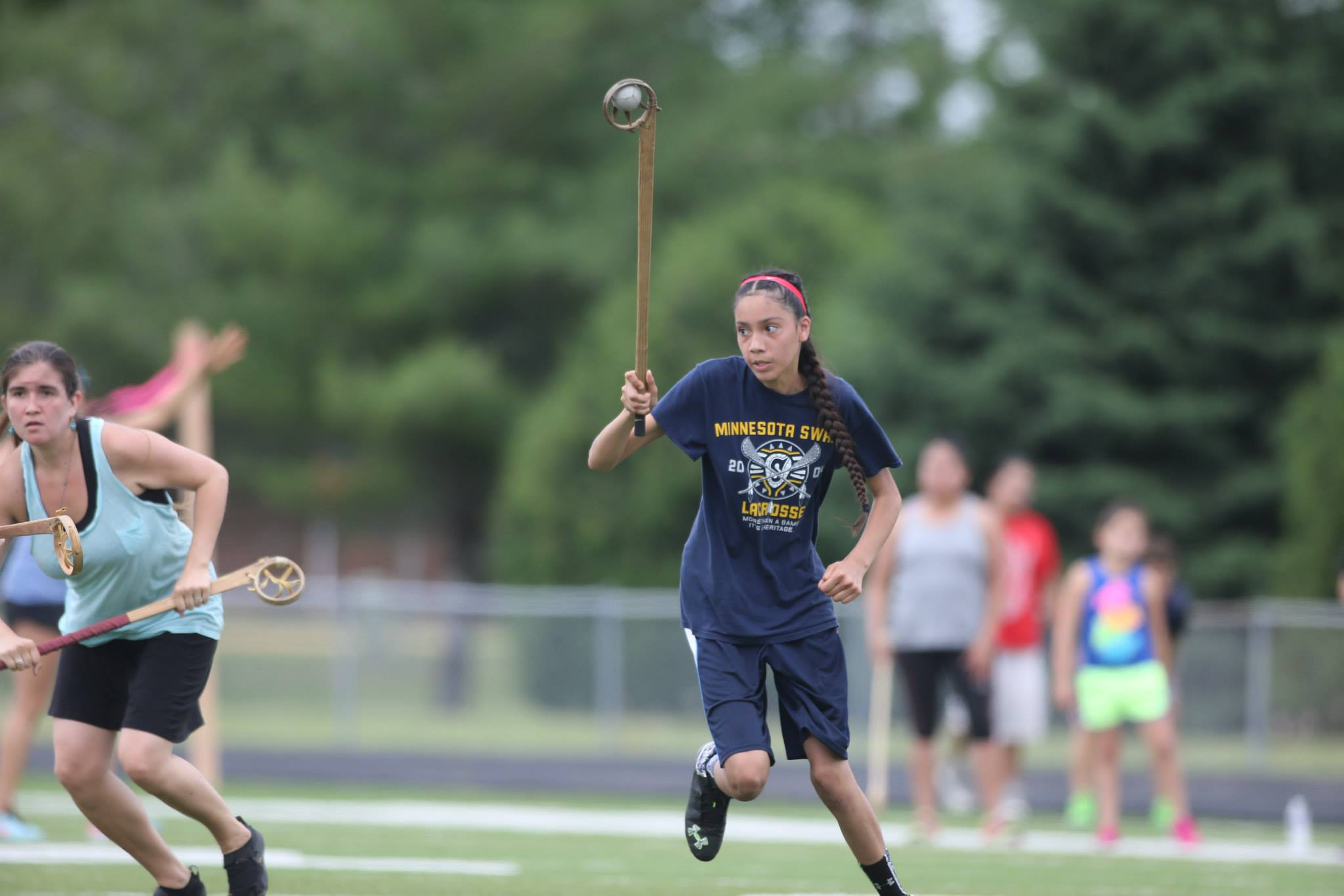 Eighth grader Nina Polk competes in the 215 wooden stick tournament. Nina and her mother, Dyani Whitehawk, are members of the adult women's team.