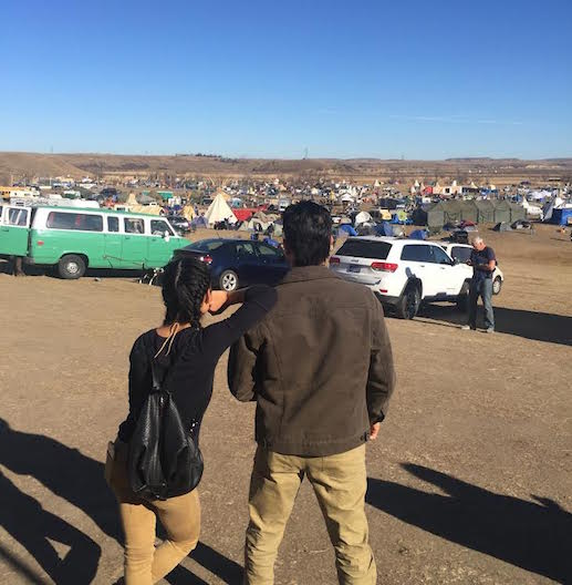 Chelsey & Thosh overlooking Oceti Sakowin camp. Photo by Bobby Wilson. (We swear it was actually candid!)