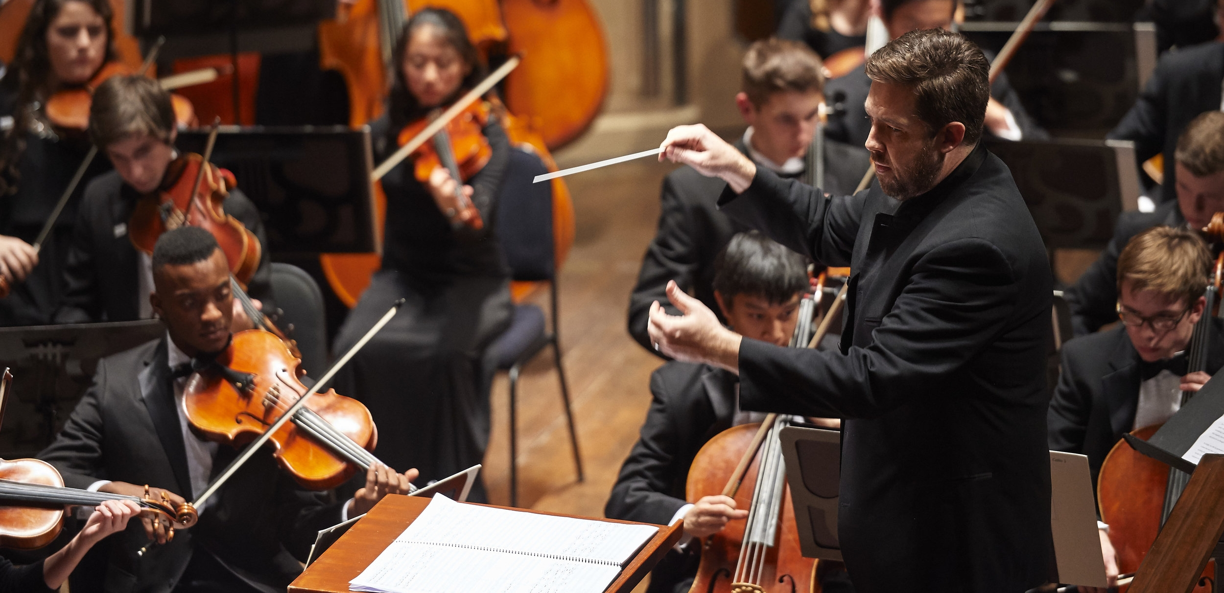 Music director Brett Mitchell leads the Cleveland Orchestra Youth Orchestra in performance at Severance Hall. (Photo by Roger Mastroianni)