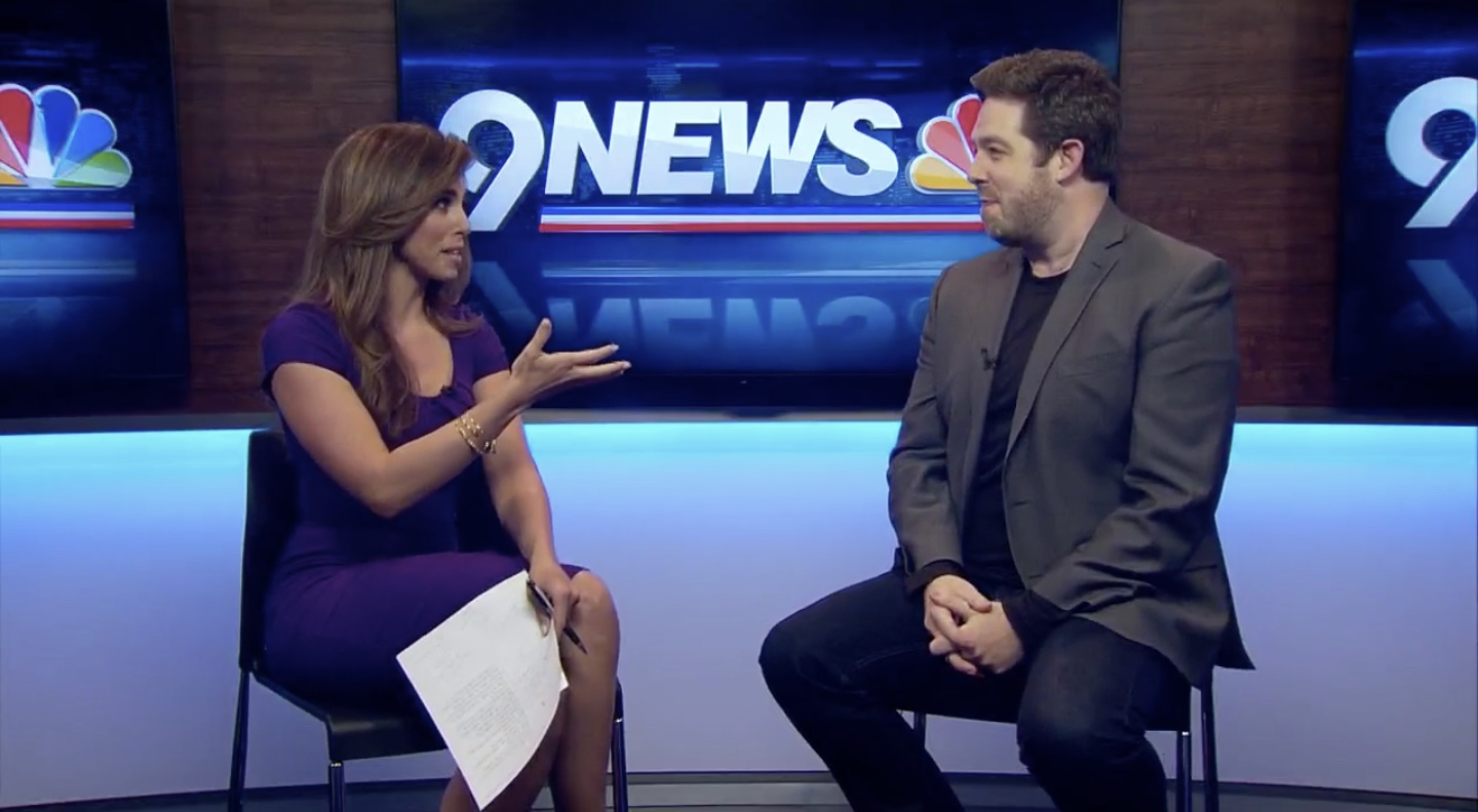 Brett Mitchell speaks with anchor Corey Rose on the set of 9NEWS in Denver.