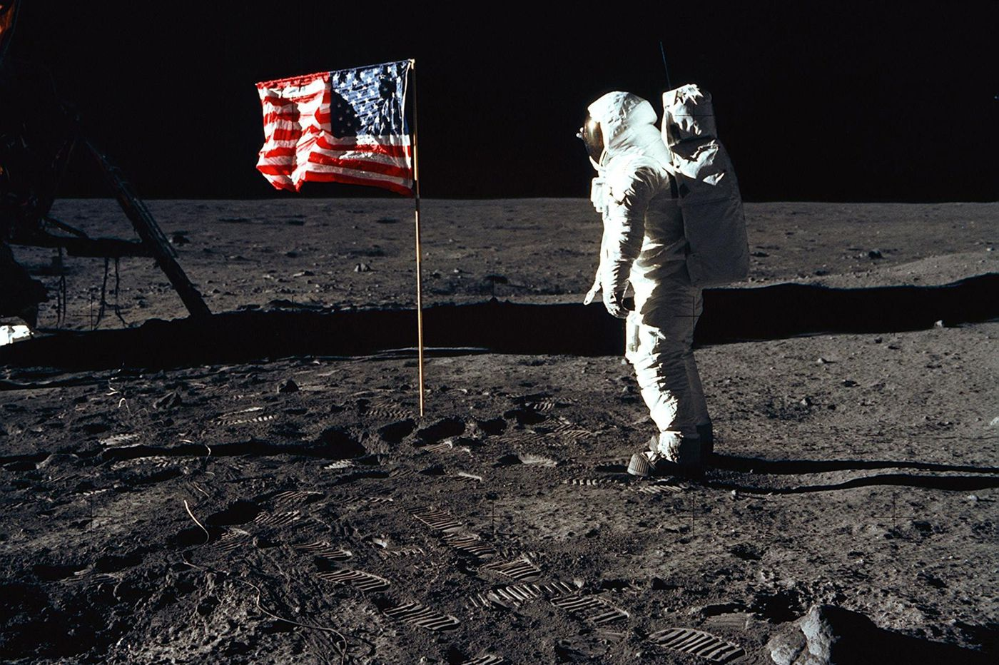 Buzz Aldrin plants the U.S. flag on the surface of the moon, July 1969. (Photo by Neil Armstrong)