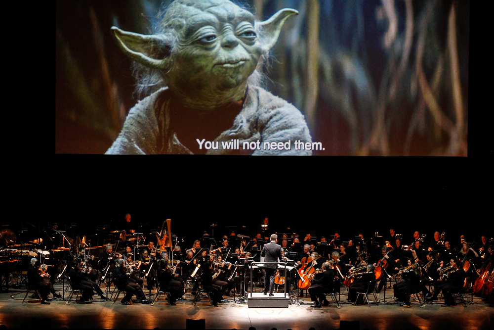 Brett Mitchell leads the Colorado Symphony in John Williams's score for  Star Wars: The Empire Strikes Back  at the 1STBANK Center in Broomfield, CO in March 2019. (Photo by Brandon Marshall)