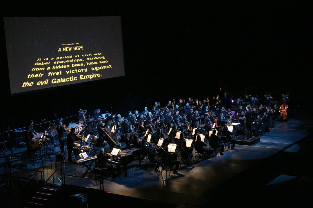 Brett Mitchell leads the Colorado Symphony in John Williams's score for  Star Wars: A New Hope  at the 1STBANK Center in Broomfield, CO in March 2018. (Photo by Brandon Marshall)