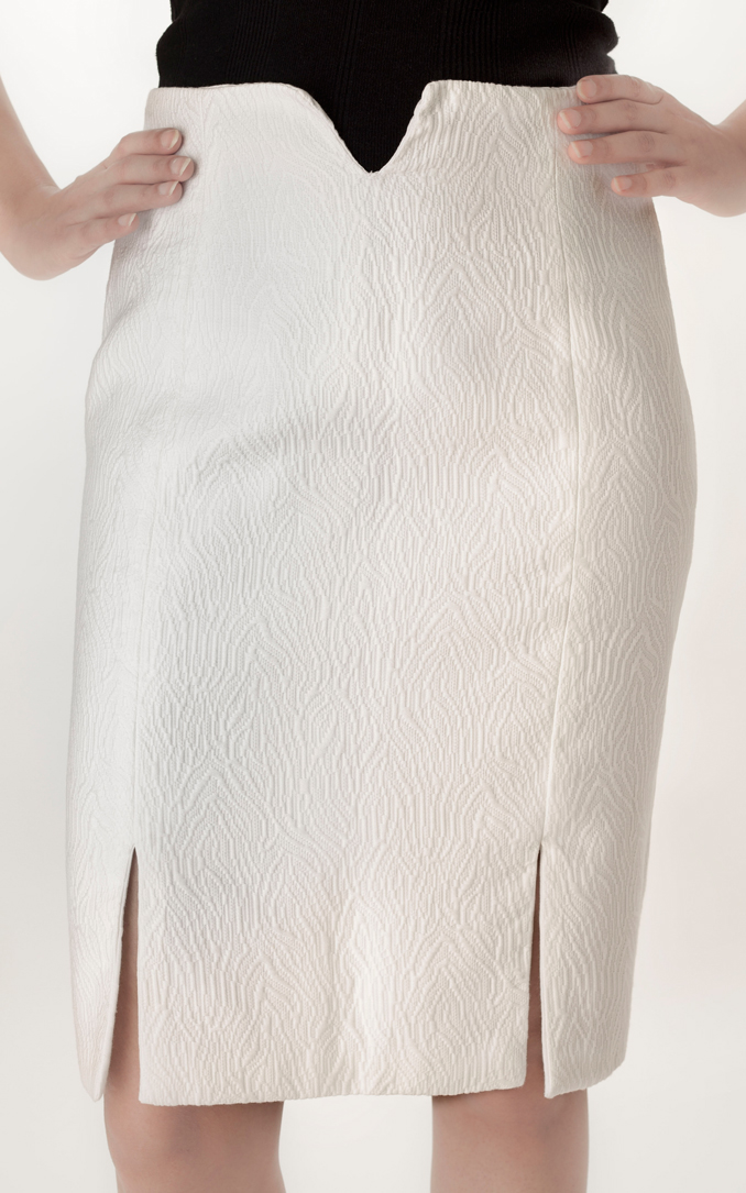 PENCIL SKIRT   This elegant high waist pencil skirt helps add a twist to your formal wardrobe. Made from White Brocade with slits in the front this pieces comes in a  Size 'S' .  Code : 007PS