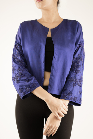 JACKET WITH EMBELLISHED SLEEVES   This is the perfect jacket to help add some glam to your outfit. Made from 100% Cotton Satin Silk, the sleeves are embellished with a combination of beads in swirl motifs. The jacket is completely lined to give it a perfect finish. Dry clean only.  Code : 0036LSJ