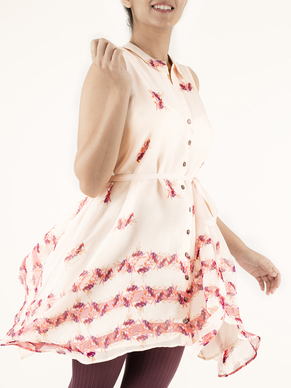 ASYMMETRICAL SHIRT DRESS   Pretty in Pink' not only describes the print, but the entire piece. This Silk Chiffon shirt has an uneven hemline and can be worn with the sash if you wish to accentuate your waistline. Dry Clean Only.  Code : 0040AS