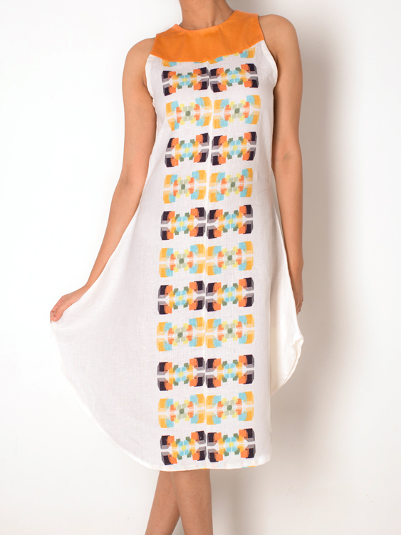 FLARED DRESS   Perfect for a hot sunny afternoon, this dress is bound to keep you cool and stylish. It has the 'Tribal Motif ' print all along the front and back, perfectly complimented with a contrast yoke in the front. Made from 100% Cotton Linen.  Code : 0014FDO