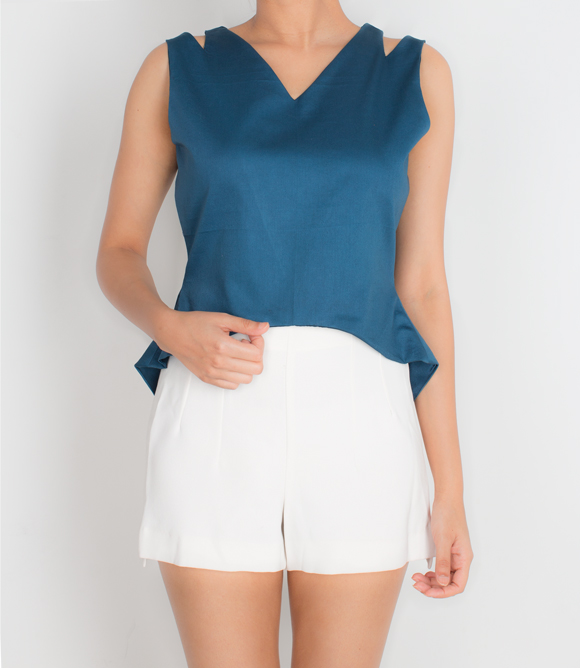 CUT OUT TOP   This simple navy blue top has a unique over lap back with cut out details at the shoulder. Made from 100% Cotton Twill and lined with soft Cotton Silk fabric.  SOLD OUT  Code : 0017COT