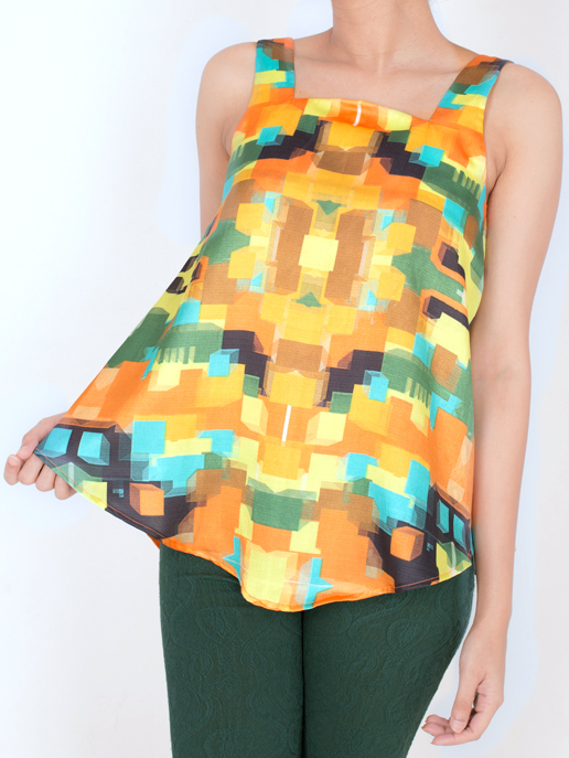 W-NECK TOP   This top has a distinct neckline while it flows freely towards the hemline. It is made from Cotton Silk and comes in the 'Pixel Mania' print. Pair it with a pair of skinny jeans and you are good to go!  Code : 0018WT
