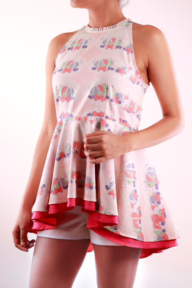 SLEEVELESS PEPLUM TOP   Fun and Flirty, this sleeveless top in the 'Macaroon Drip' print is perfect for the summer! It has delicate detailing all along the neckline and is made from 100% Cotton Lycra.  Code : 0043PT