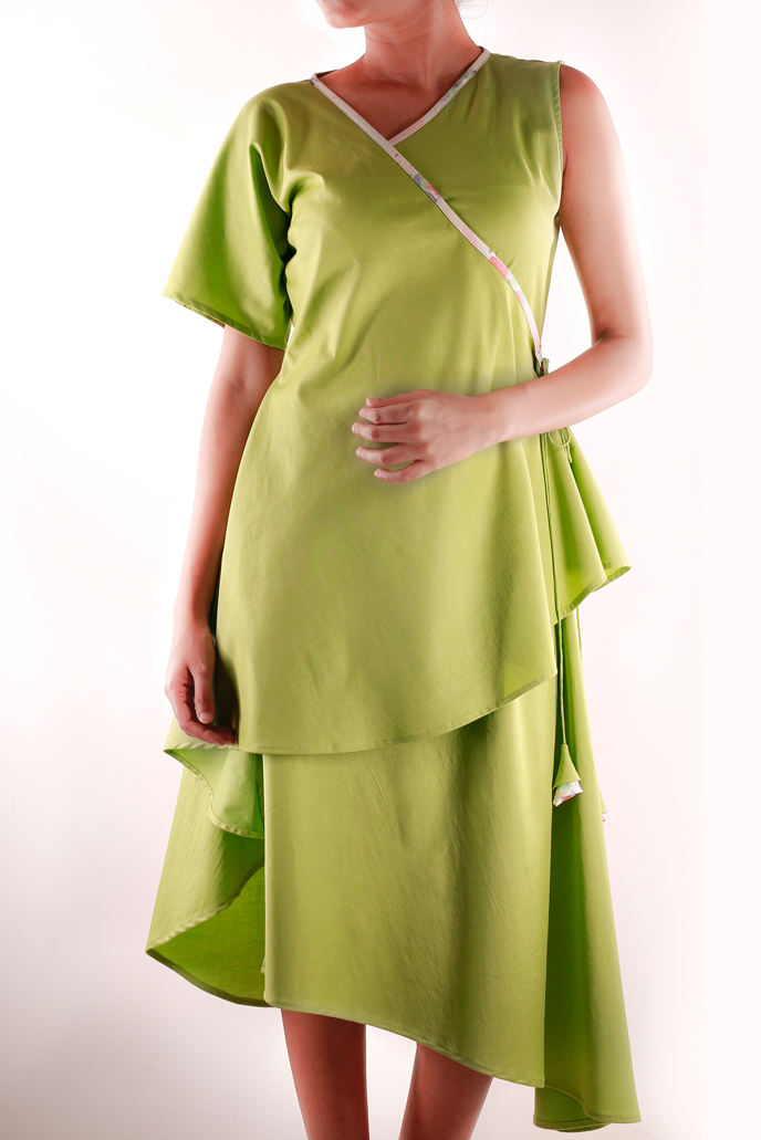 WRAP AROUND DRESS   This dress has a unique cut and is perfect for the summer. Easy and relaxed in silhouette, it comes in a light pista green and is made from 100% Cotton Lycra.  Code : 0044WD