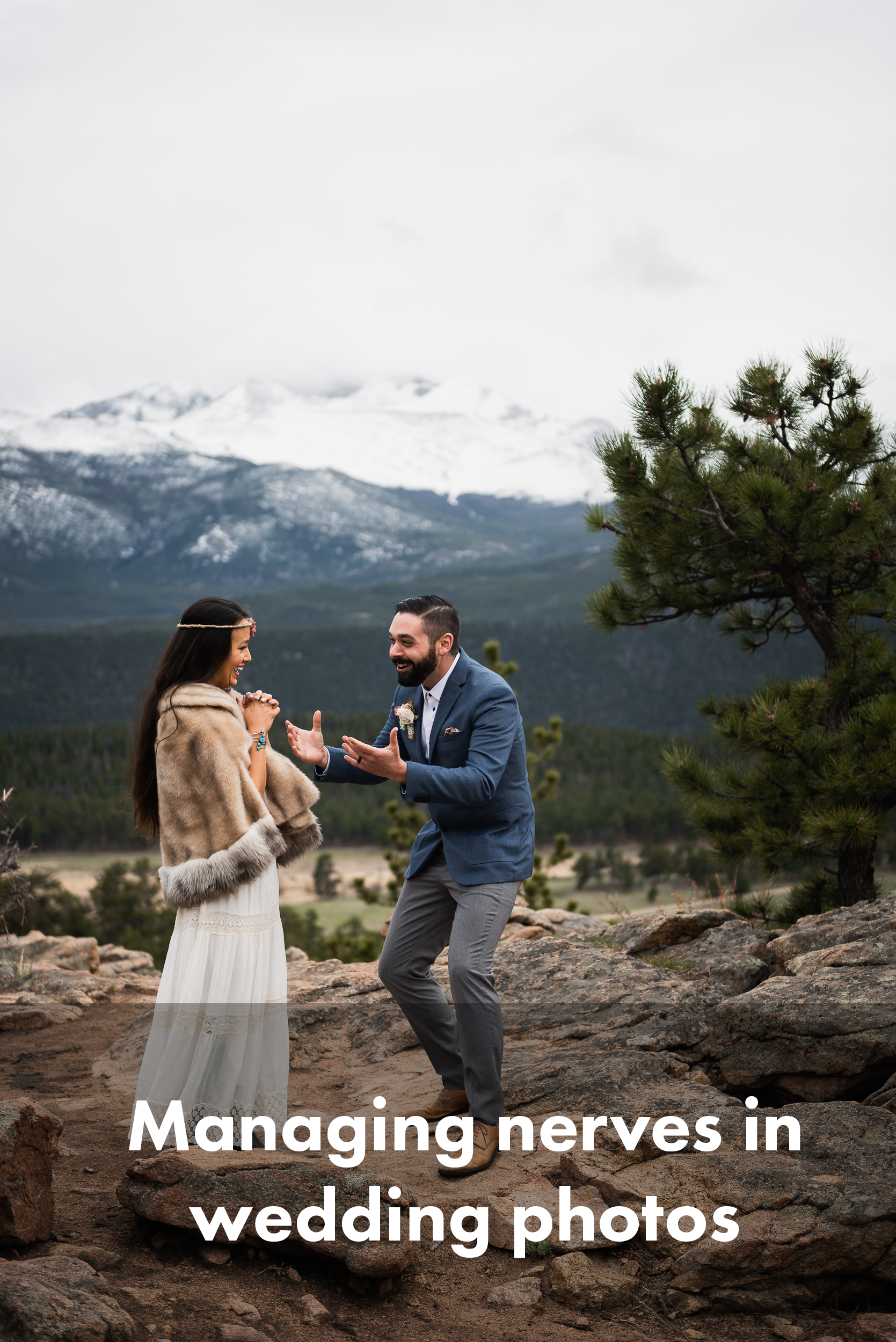 """Here's an elopement couple in colorado that just finished their ceremony, ecstatic. The groom at right is gesturing with his hands, saying """"We're MARRIED!"""" and the bride at left is clasping her hands in excitement. They're both smiling big and looking at each other. They're standing on rocks, with snowy peaks behind them."""