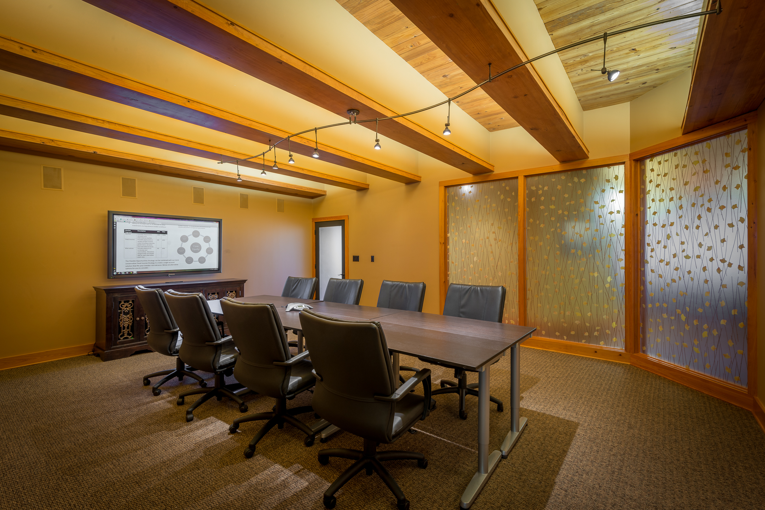 "Hassell Wealth Management   Houma, LA -  Conference Room  A 65"" Panasonic commercial plasma monitor, along with 6 Sonance in-wall speakers and hidden electronics give this conference room the potential for full blown multi-media presentations."