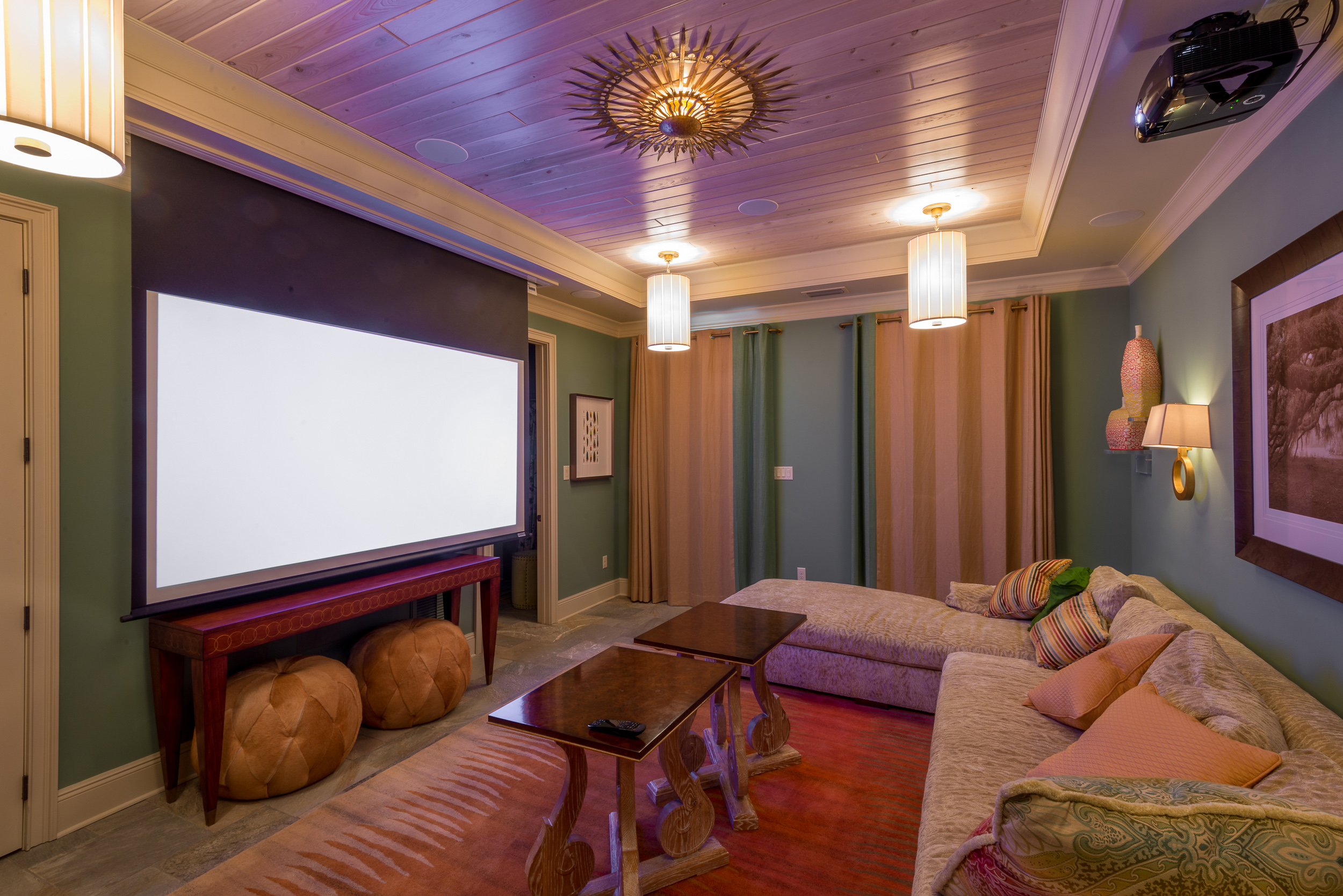 "The piece de résistance of this residence is the designated theater room. The impressive audio/video system remains unheard and out-of-sight until the massive Vutec 103"" motorized film screen drops out of the ceiling.  That's when jaws drop too!  See the video below."