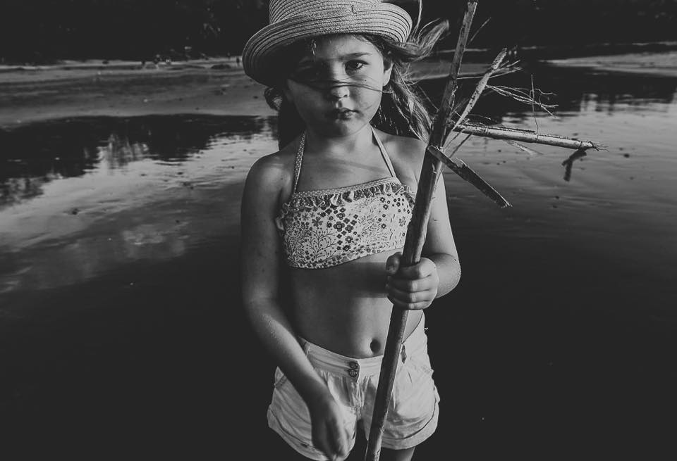 """""""This one of my daughter Olivia in Costa Rica. Just the two of us went there last January, our first big adventure together. I love this shot of her playing castaway at Playa Pelada. She was having more fun than her expression here suggests..""""  Schriver Photo"""