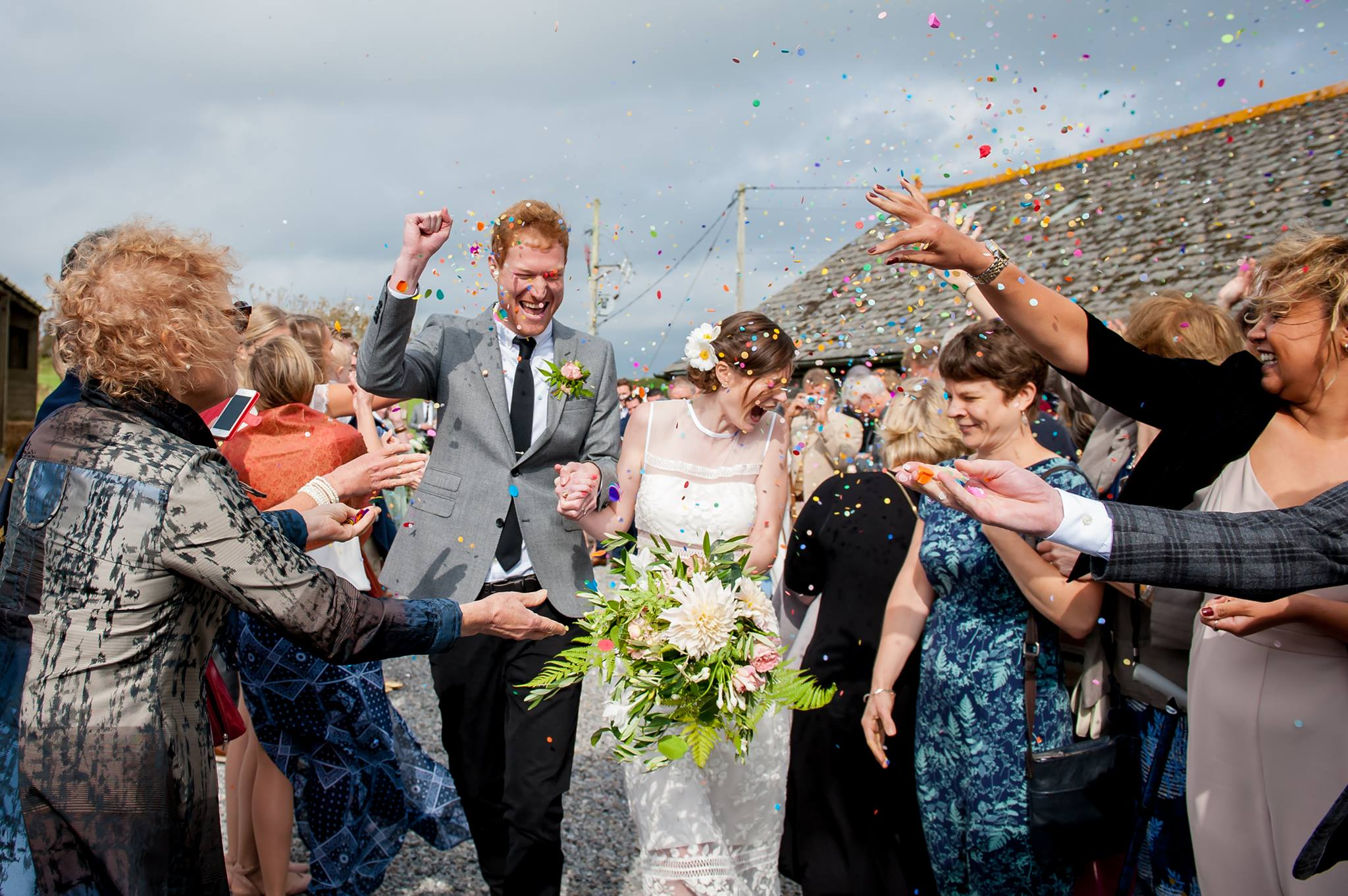 Photo of a wedding couple with confetti after the ceremony