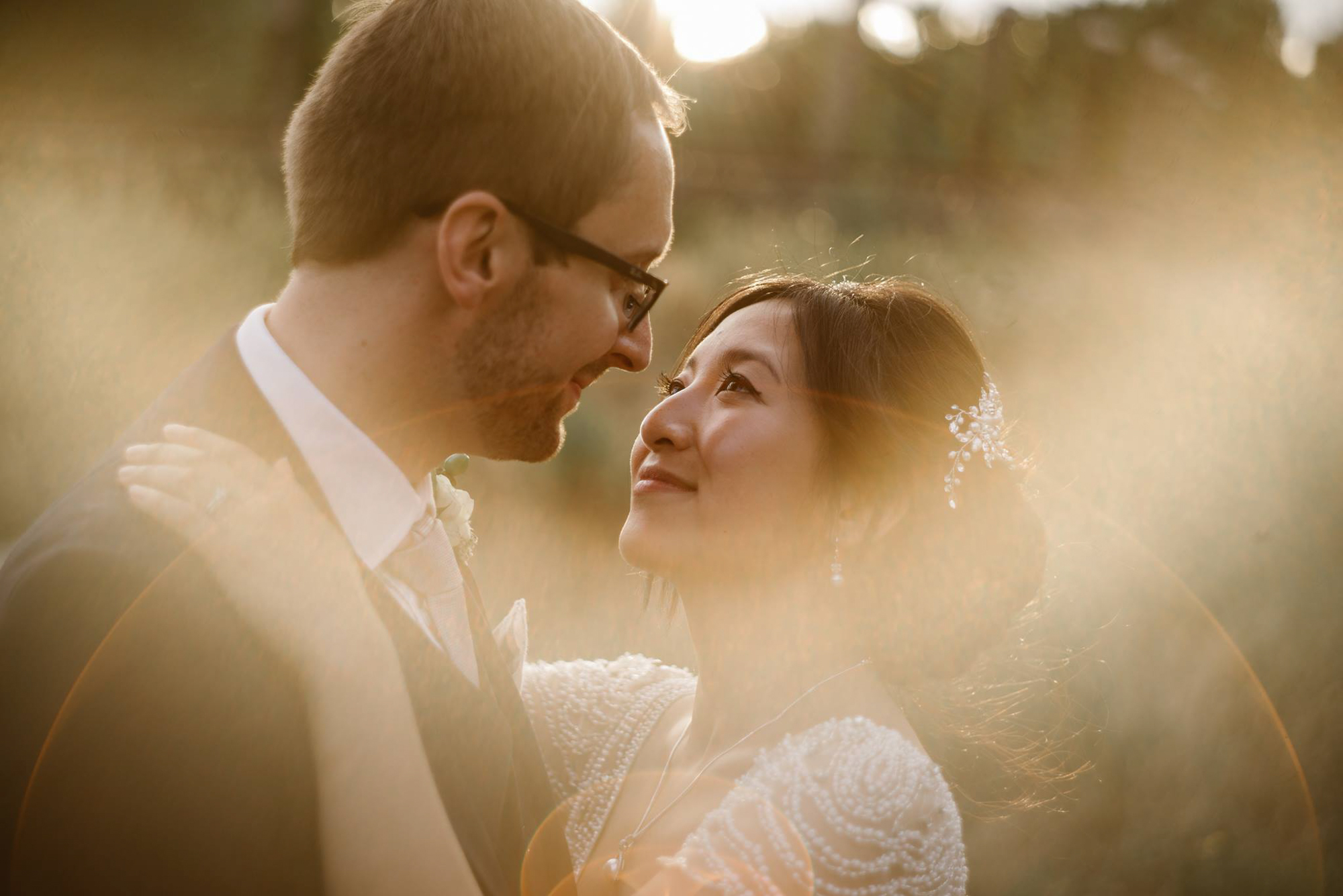 Photo of a bride and a groom in the golden light taken by a wedding photographer