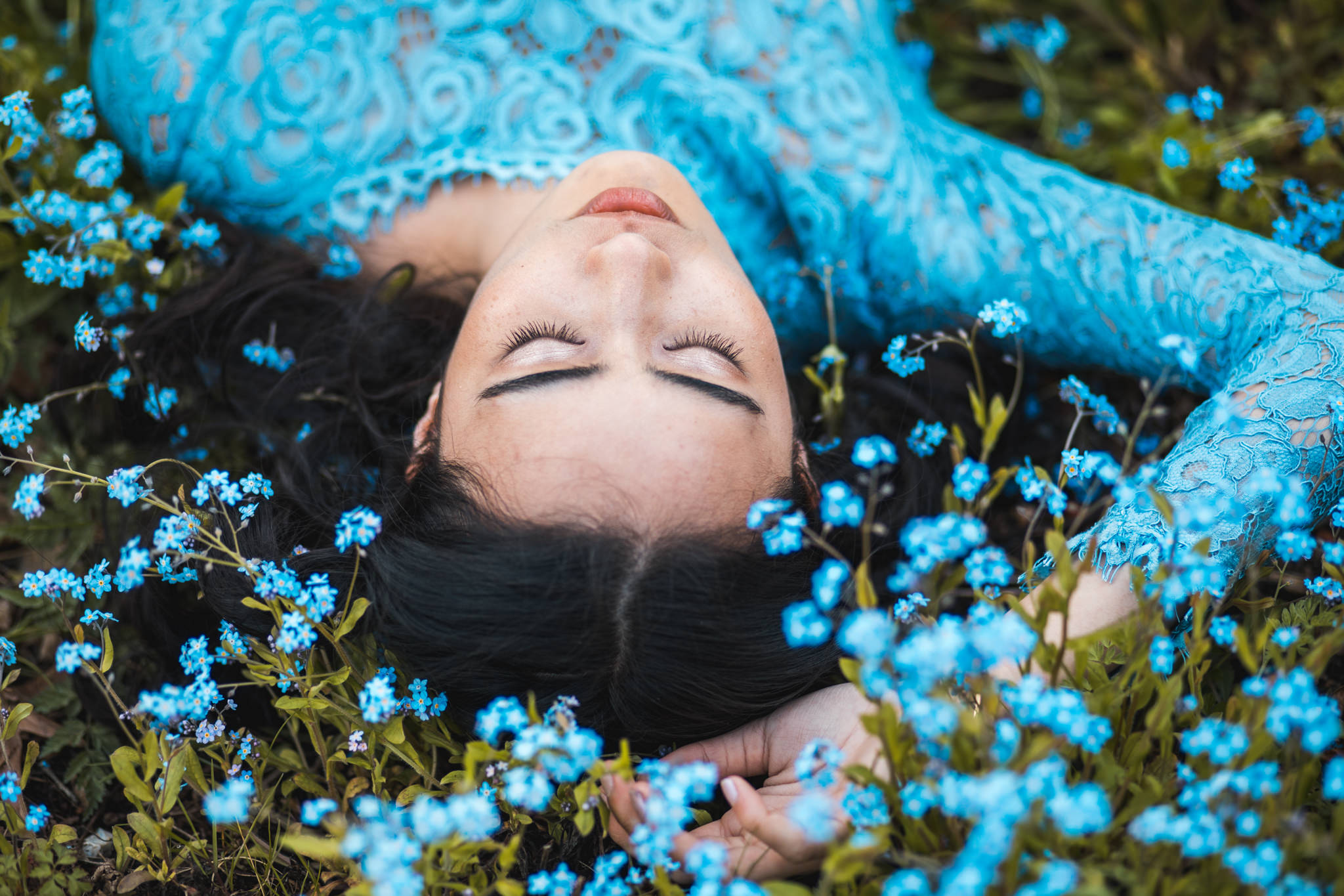 Model lying on a field from a styled shoot taken at SNAP 2018