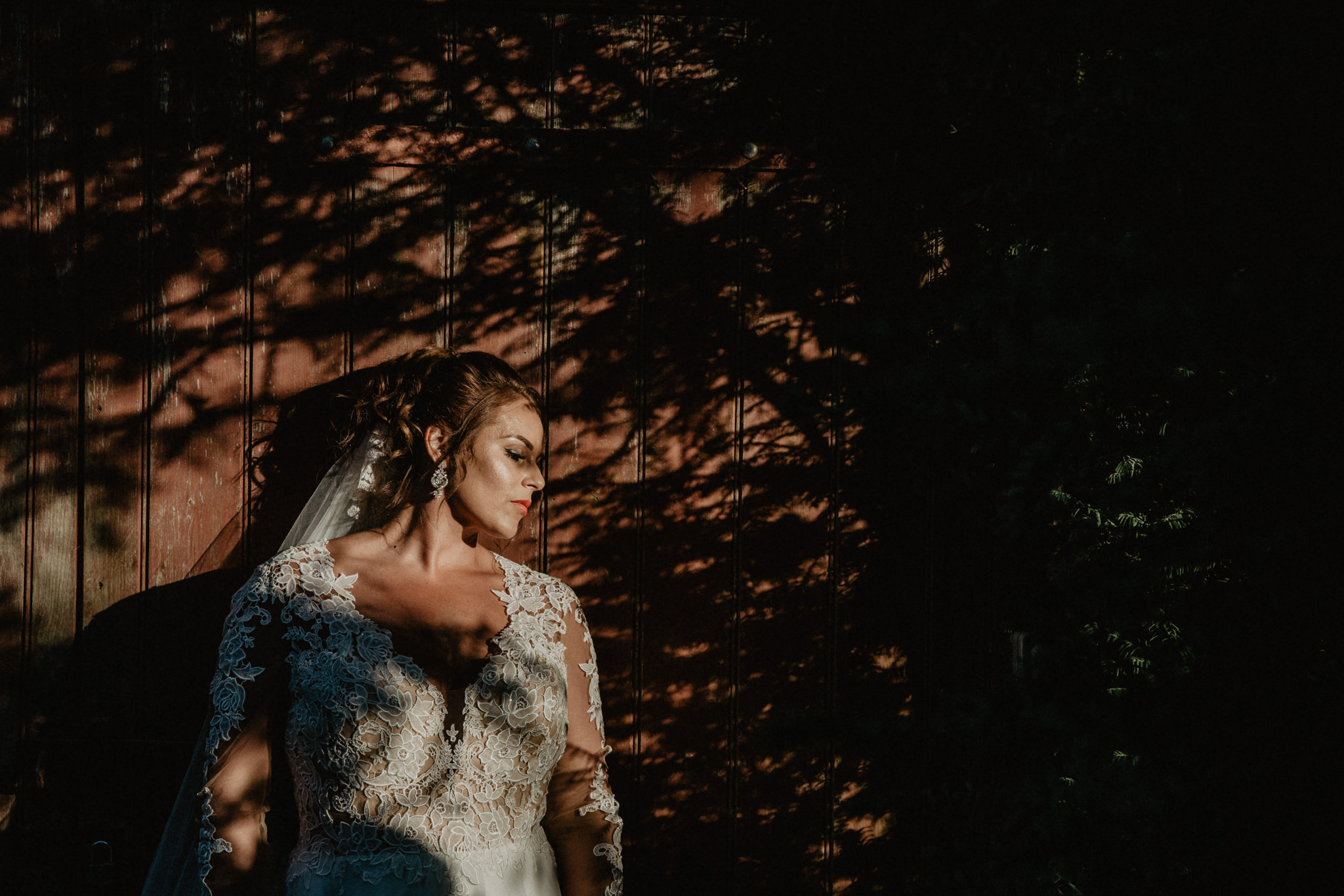 Bride standing in the shade