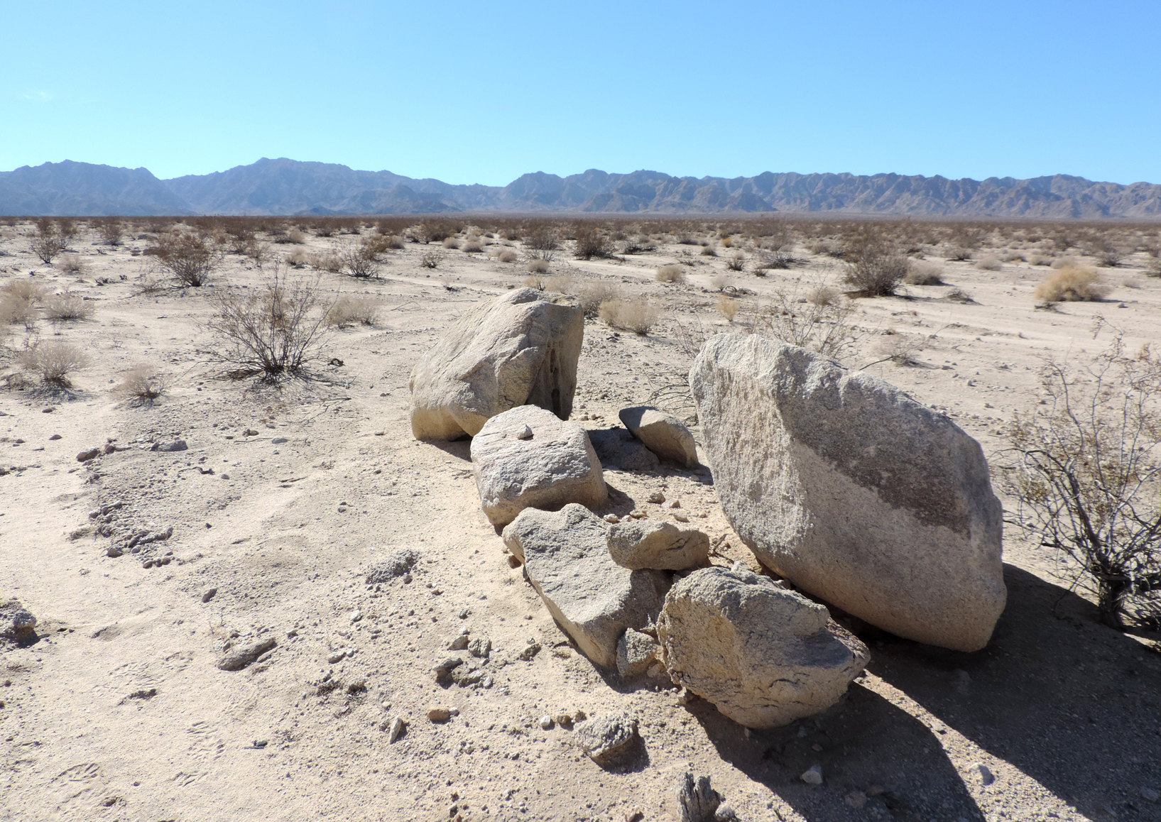 The white granitic bajada of the Cadiz Valley, with Calumet and Sheephole Mountains in the distance.  Mojave Desert, California.