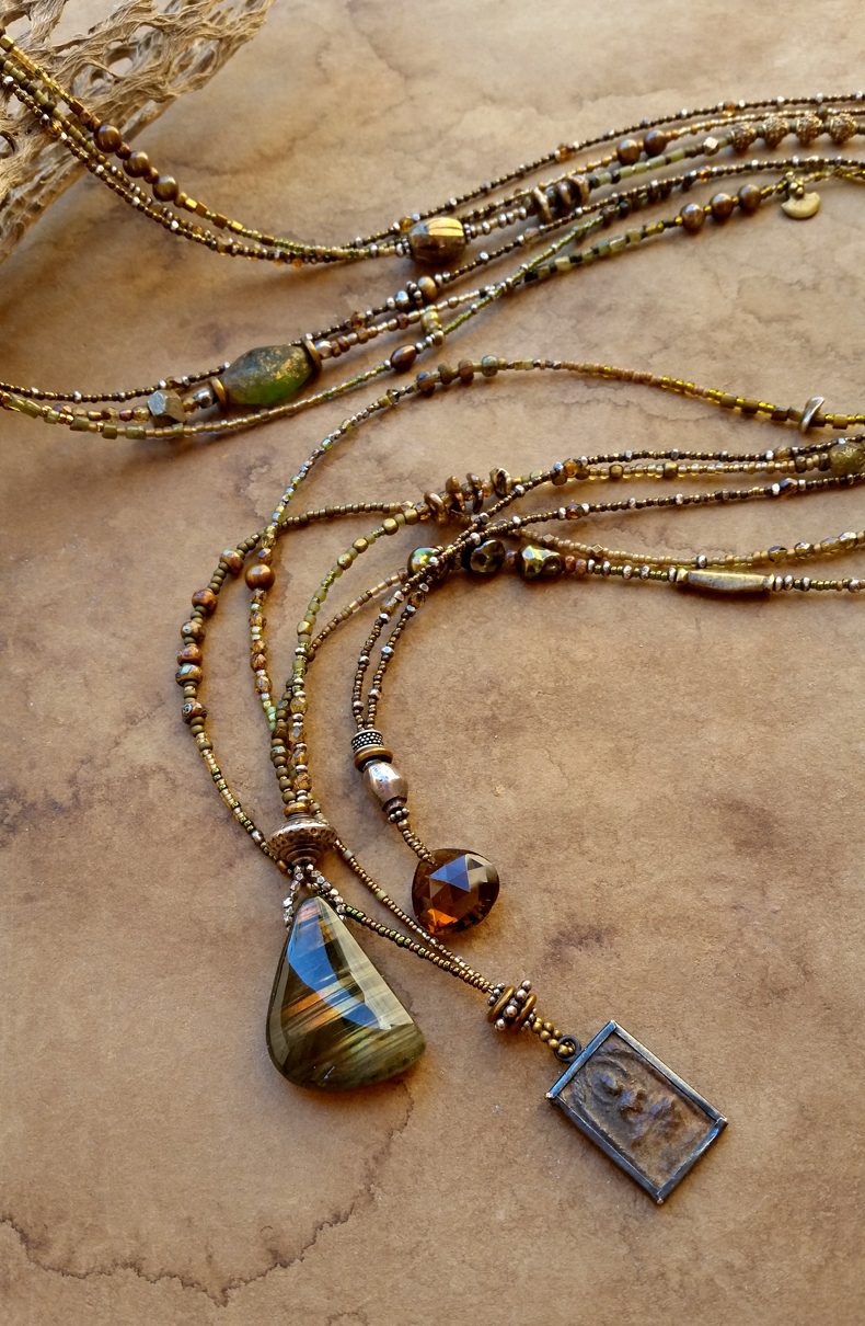 Of The Green Earth: a trio of finely-beaded extra-long necklaces in desert greens.