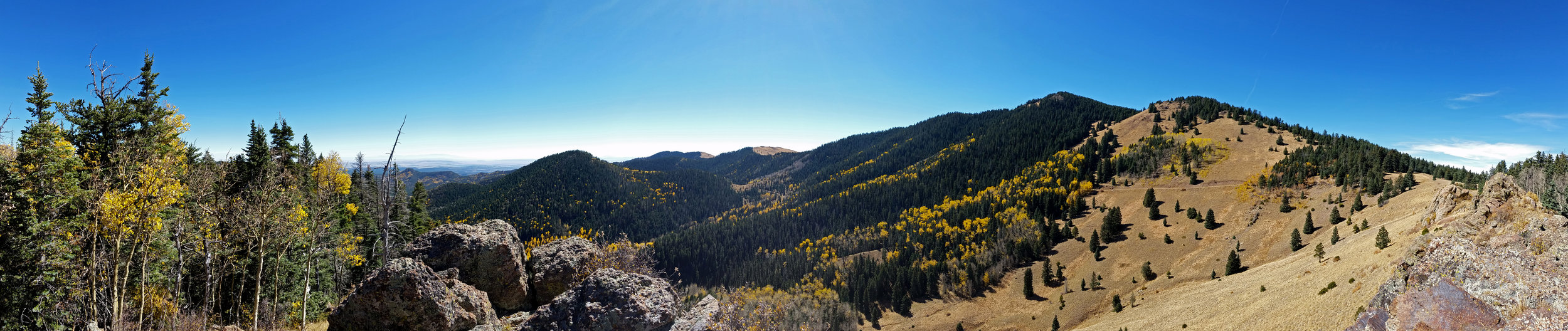 180+ degree panorama, taken from my ceremonial site in the Mt. Taylor caldera.  The 11, 305' summit is on the center right.  Click on this and all subsequent images to enlarge.