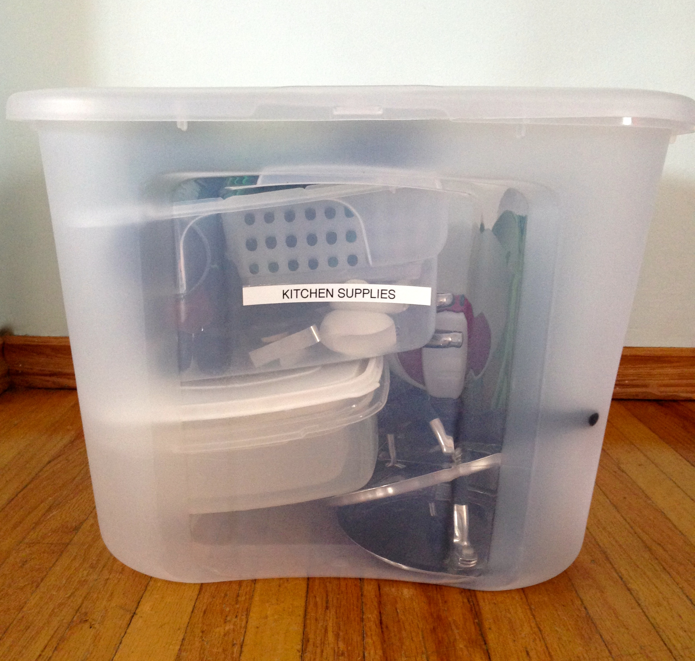 Pack all your kitchen and camping essentials in sturdy clear bins- makes it so easy to find everything!