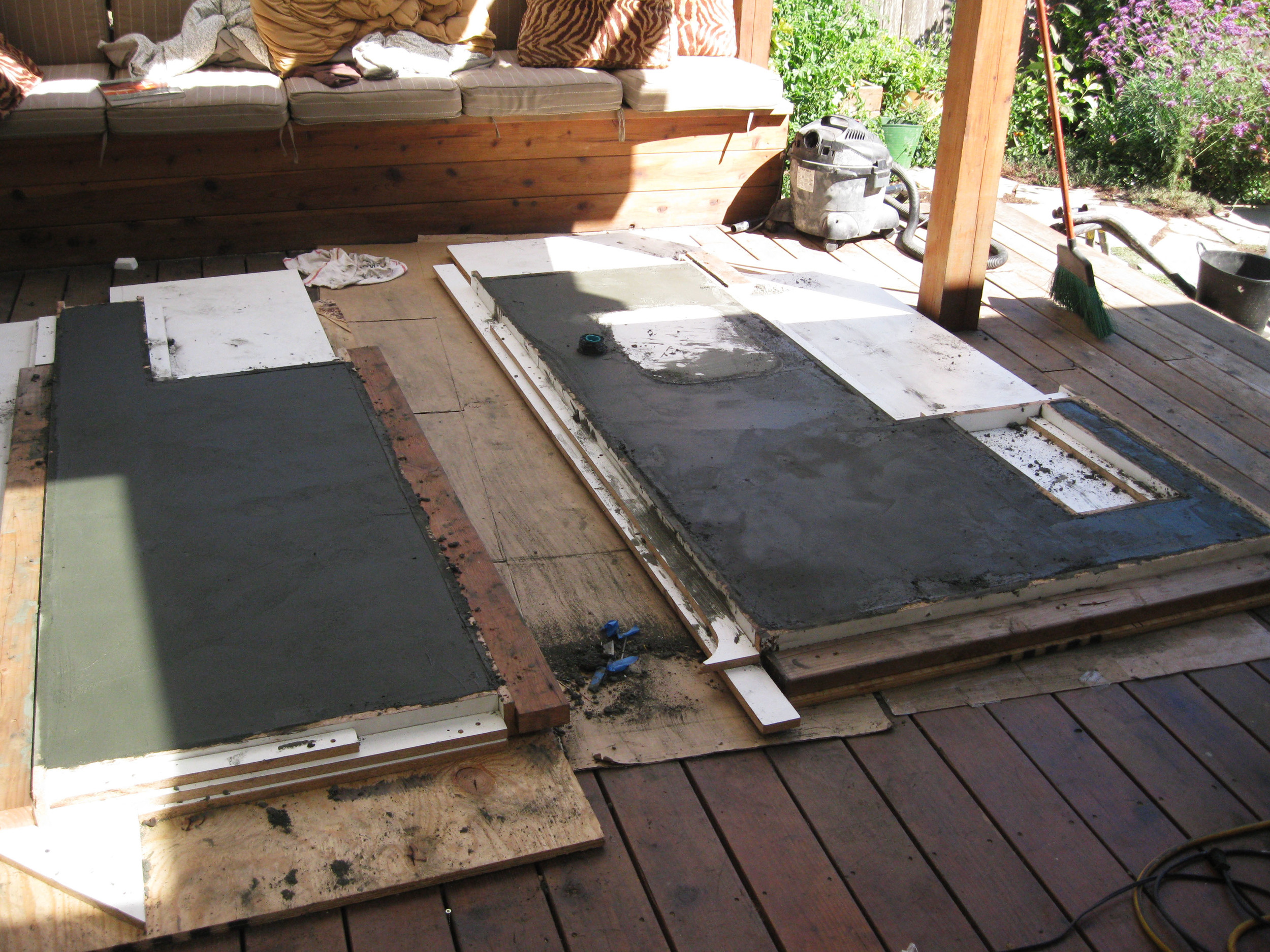 Shown here are both molds with the poured concrete curing.