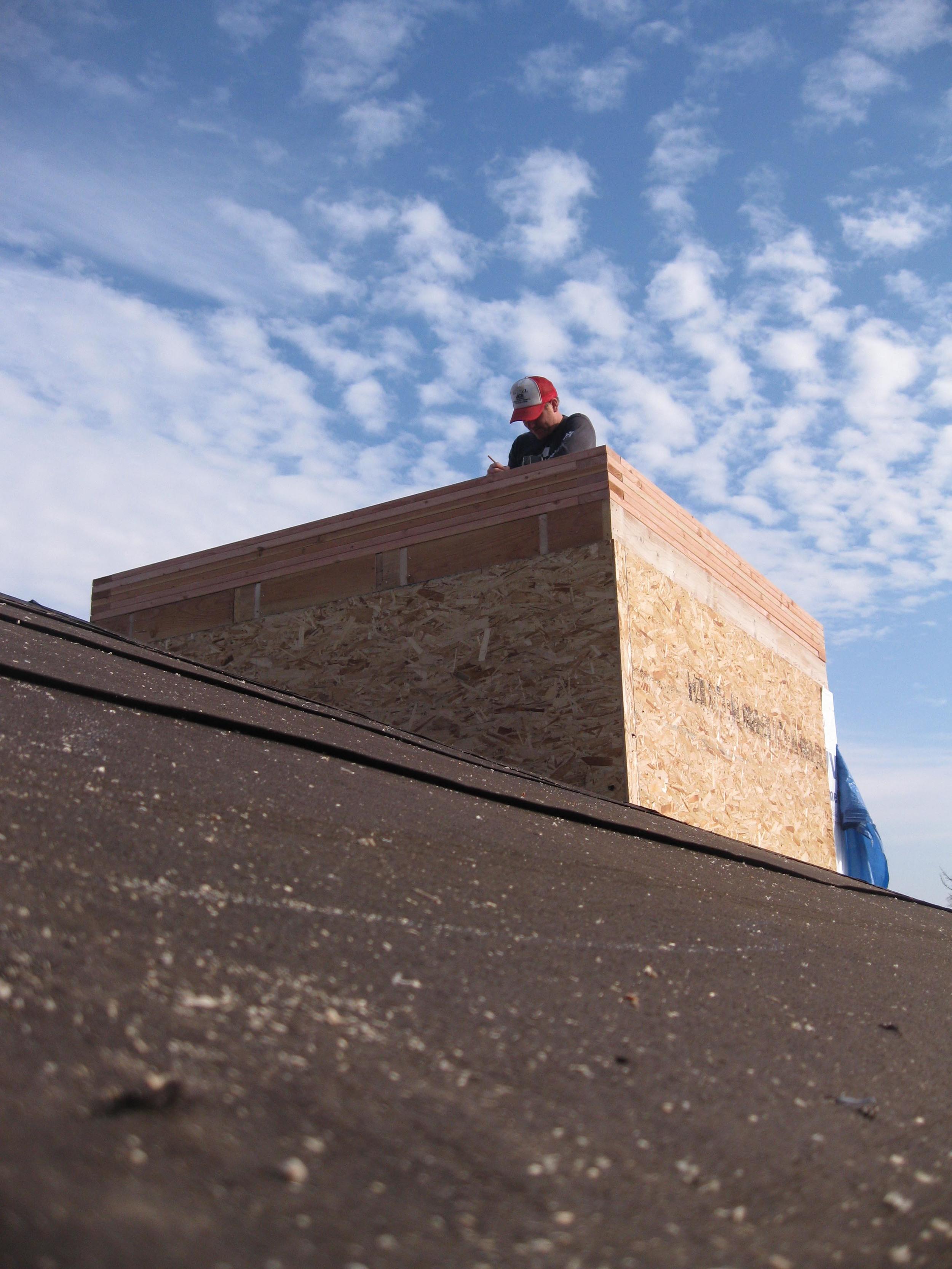 Morgan framing the tower roof.