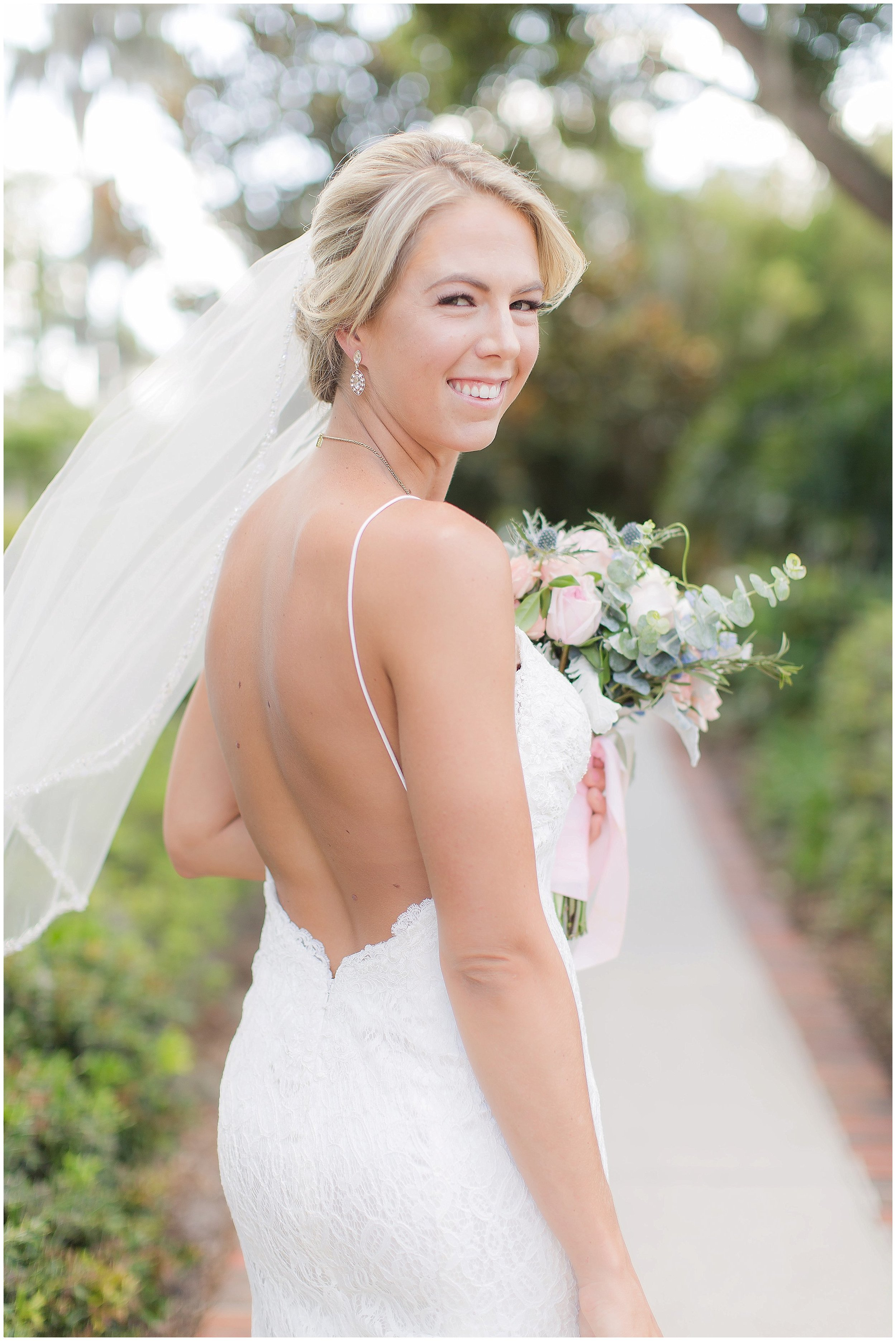 Bridal Portrait in summer gown with low cut back and short veil