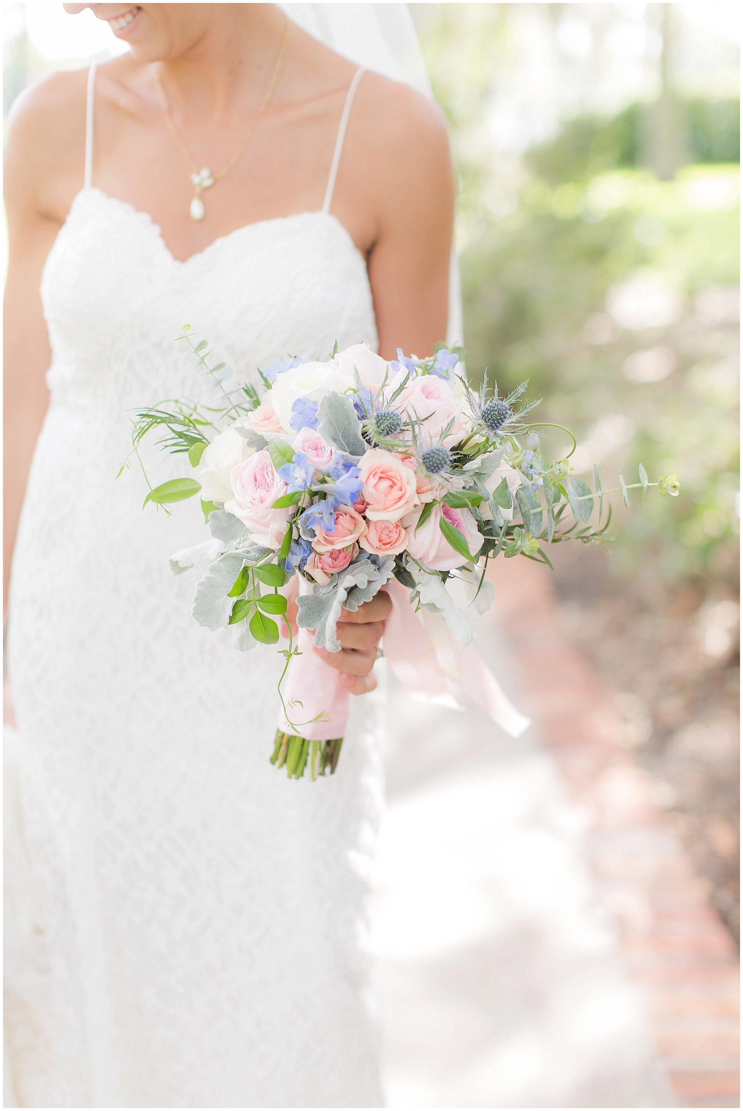 Summer Wedding gown with dusty blue and rose bouquet