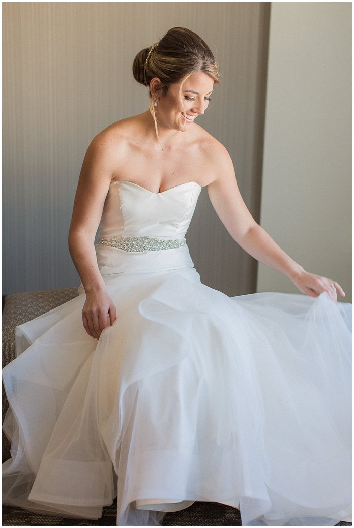 Bride Getting Ready in Hayley Paige Wedding Dress with Low Bun