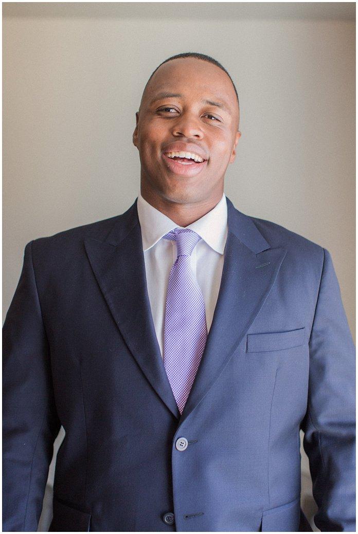 Handsome Groom in Navy Suit with Purple Tie