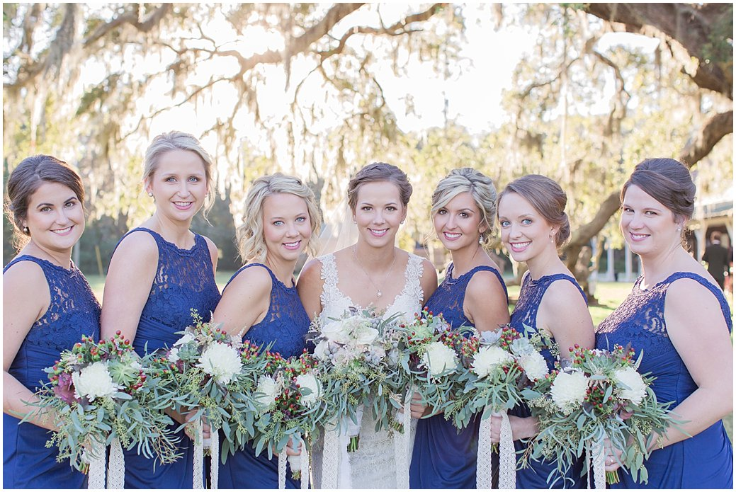 Bridesmaids in Navy with White Bouquets with berries and lace ribbon
