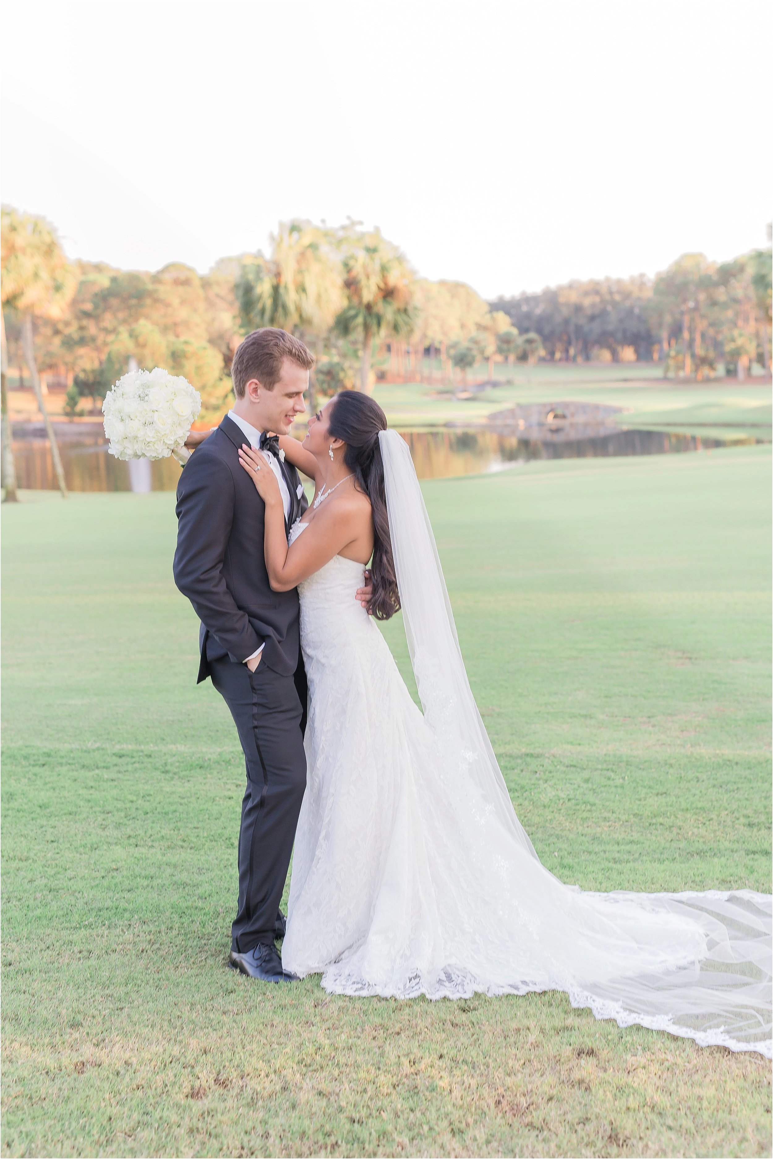 Romantic Bride and Groom Portraits with all white bouquet and tux