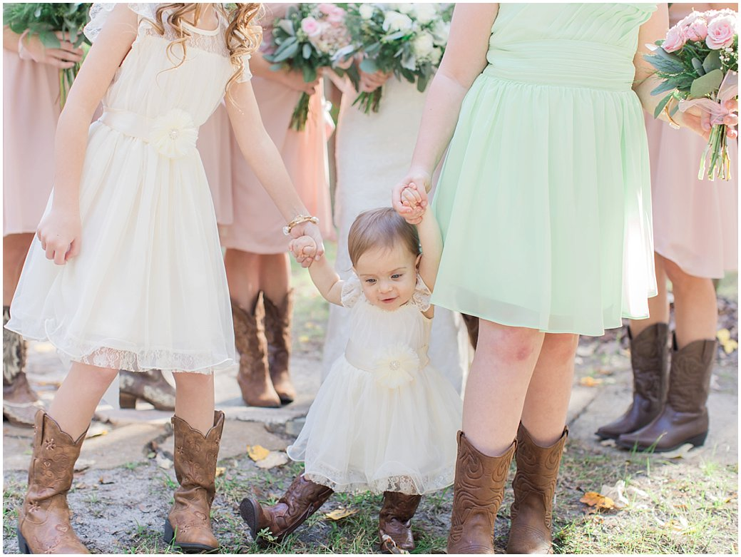 Bridle Oaks Wedding in DeLand Florida Flower Girl In Cowboy Boots with Bridesmaids Blush Wedding