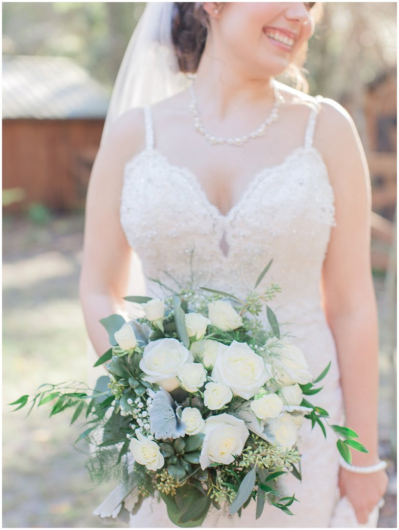 Lush Greenery Bridal Bouquet with White Roses Italian Ruscus and Dusty Millers