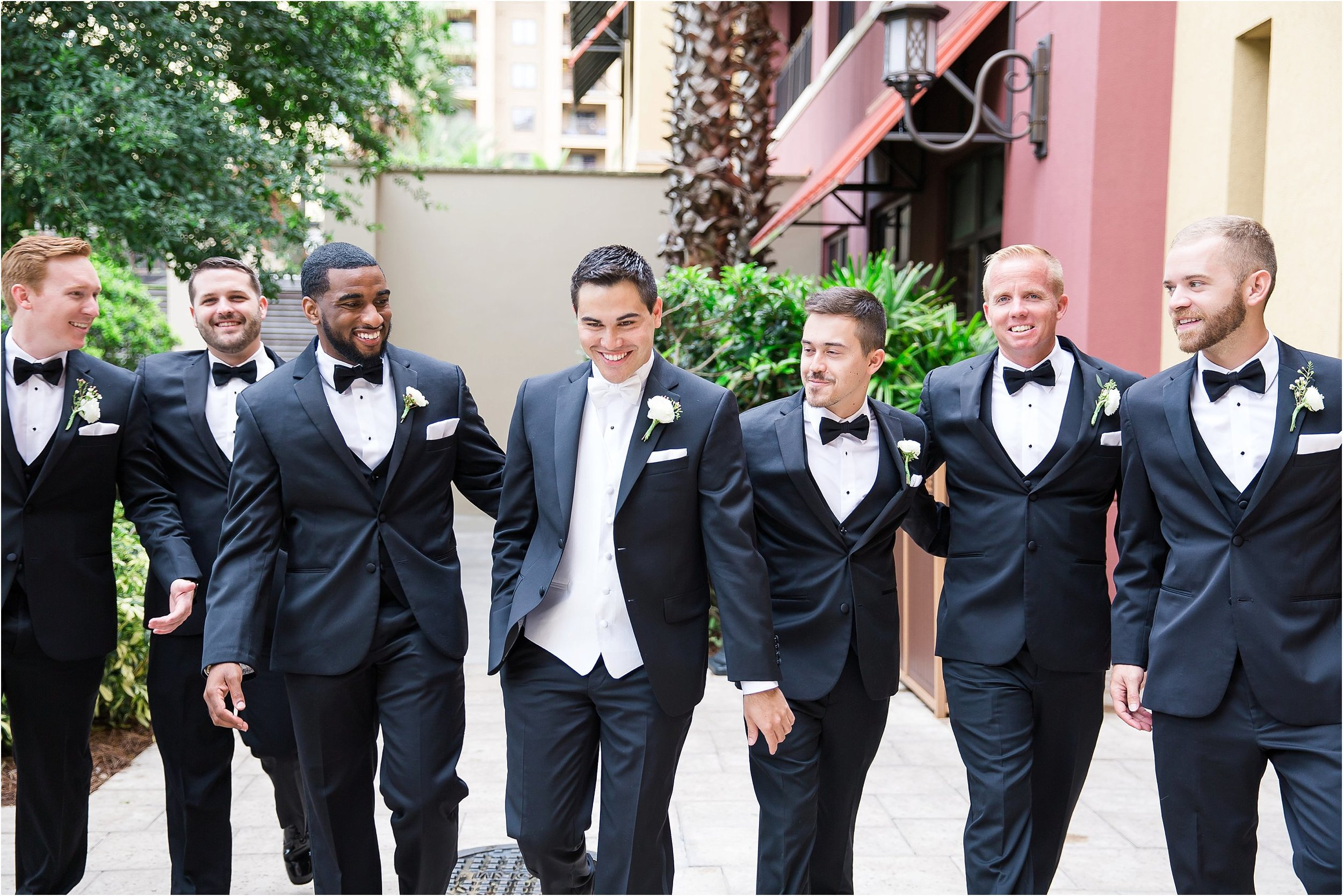 Groom portraits with ranunculus boutonniereat Wyndham Grand Resort at Bonnet Creek wedding by PSJ Photography