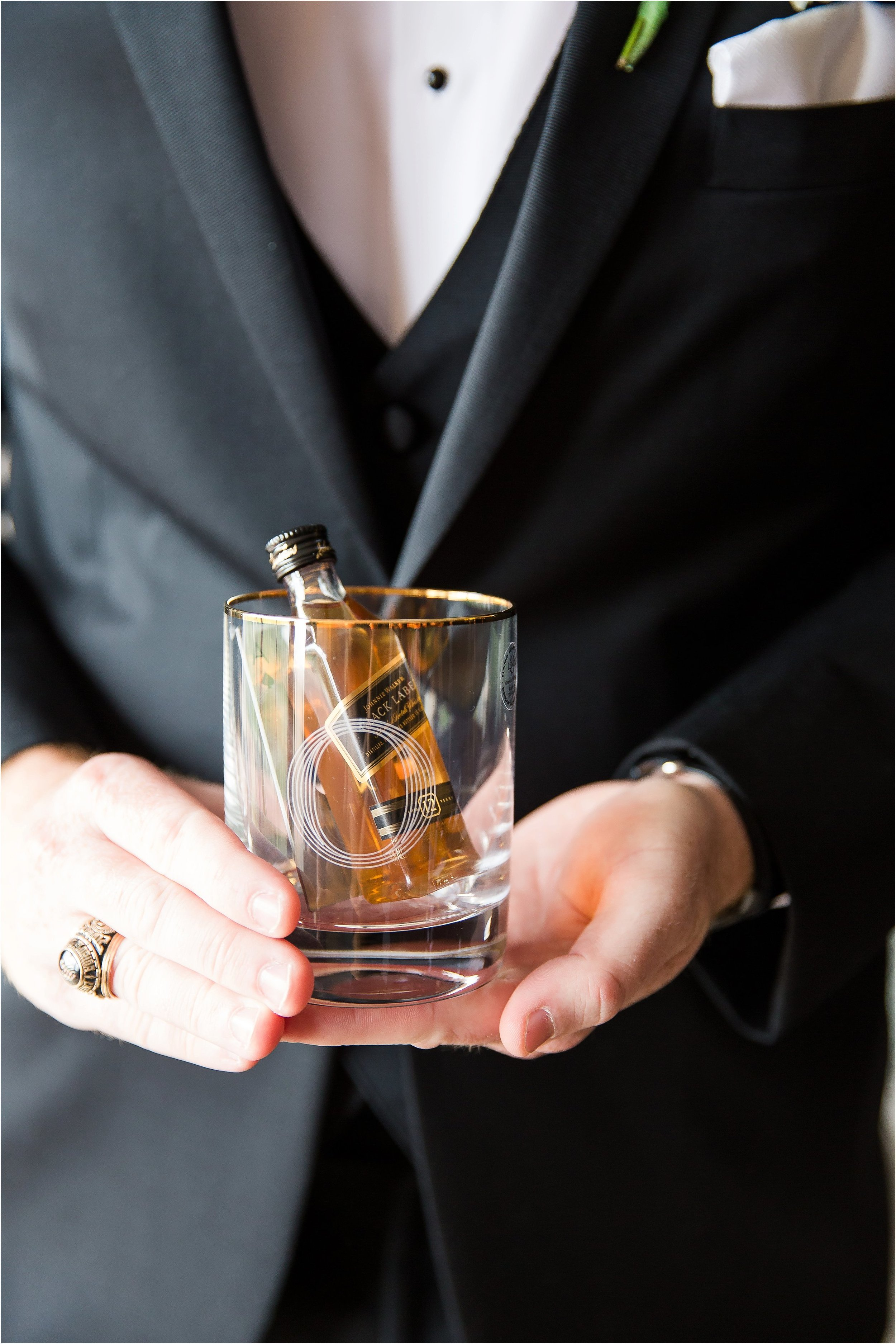 Groom gifts to guys of whiskey glasses and nips in classic tux with white vest and bowtie getting ready moments at Bonnet Creek Wedding by PSJ Photography