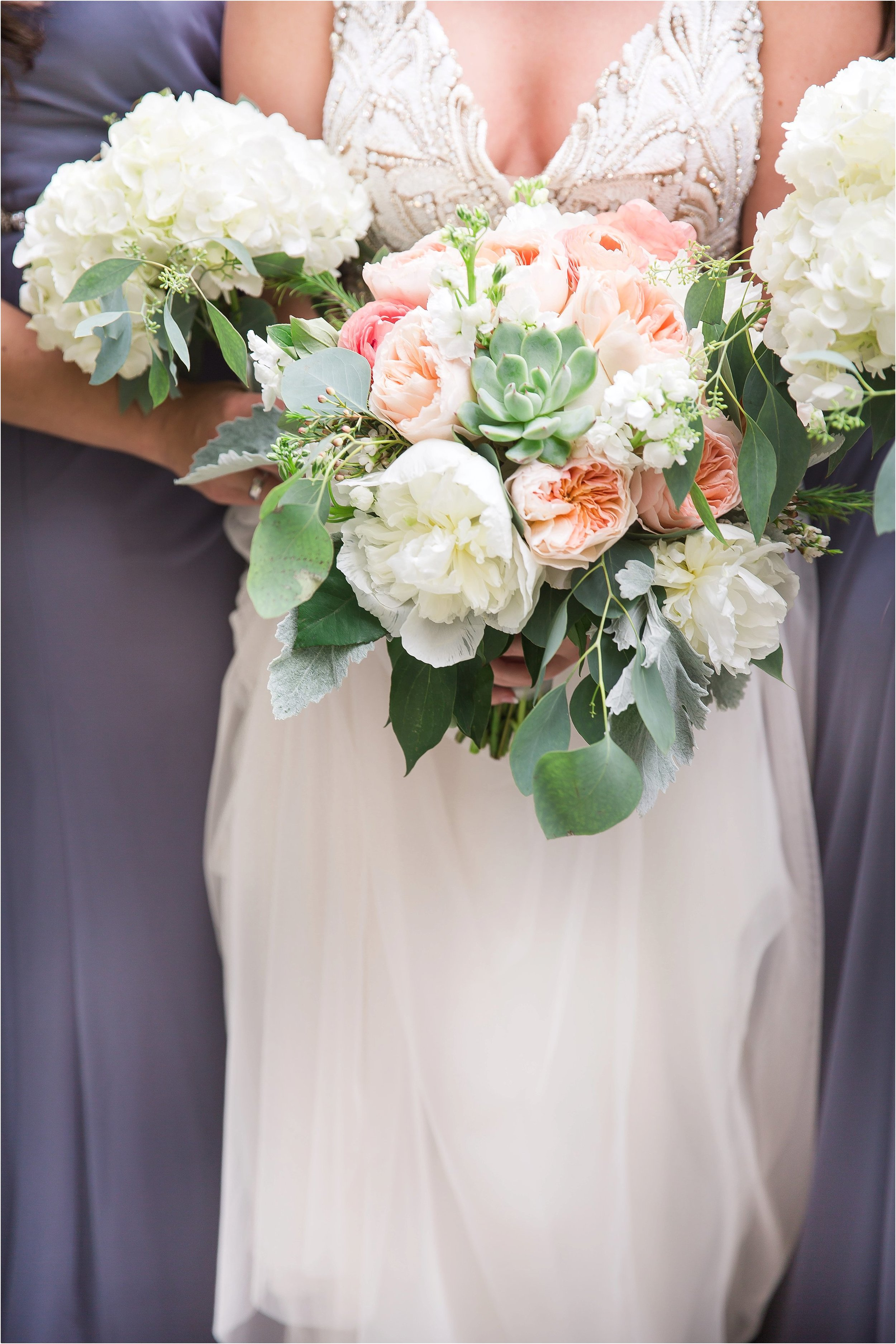Bridesmaids in grey with white bouquets at Wyndham Grand Resort at Bonnet Creek Wedding
