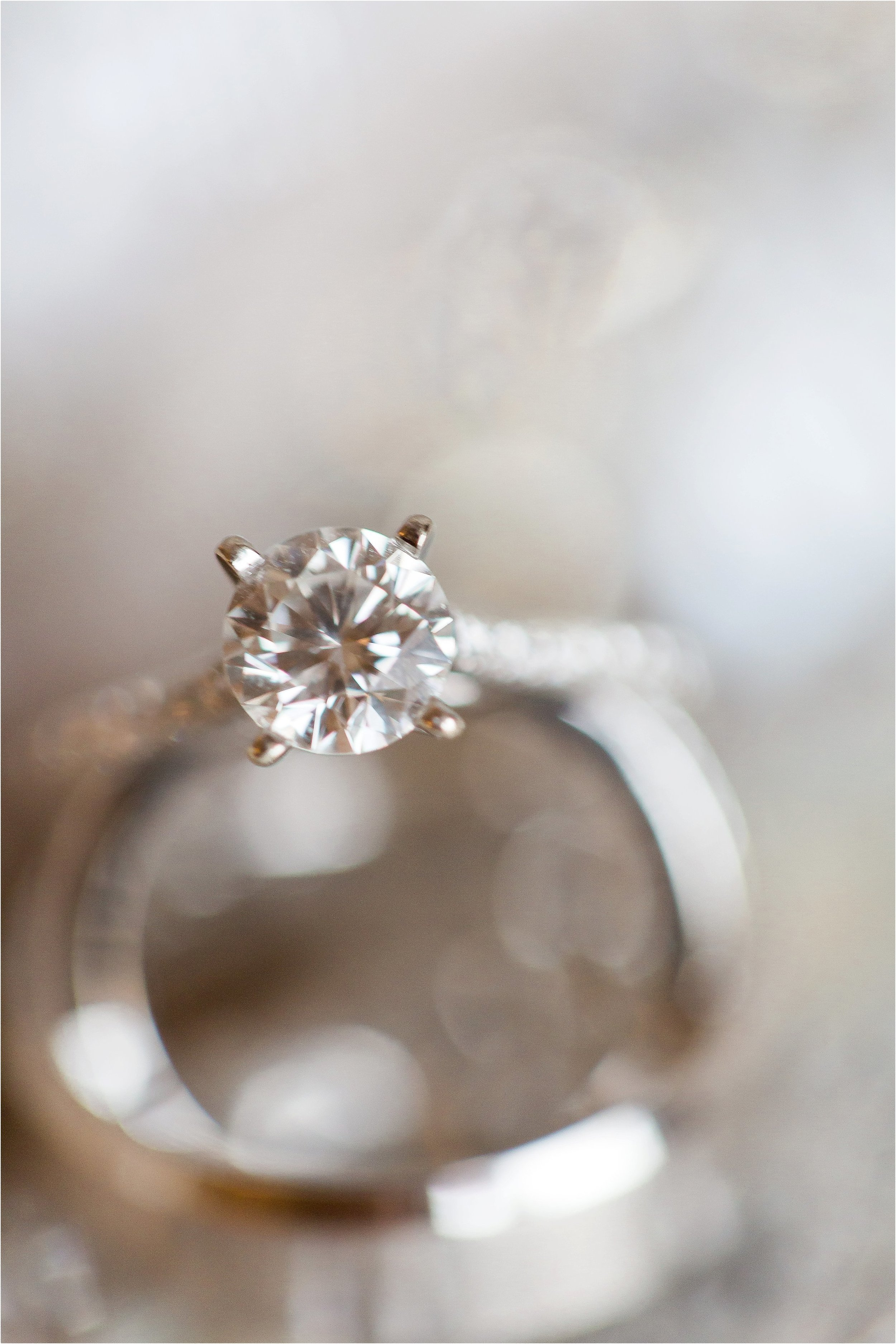 Solitaire diamond setting and platinum wedding bands at Wyndham Grand Resort at Bonnet Creek Wedding by PSJ Photography