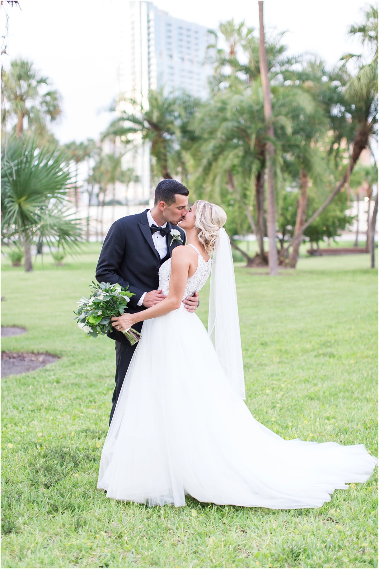 Formal Portraits at Tampa University Oxford Exchange Wedding Tampa PSJ Photography in Maggie Soterro Lisette and black tux and bow tie